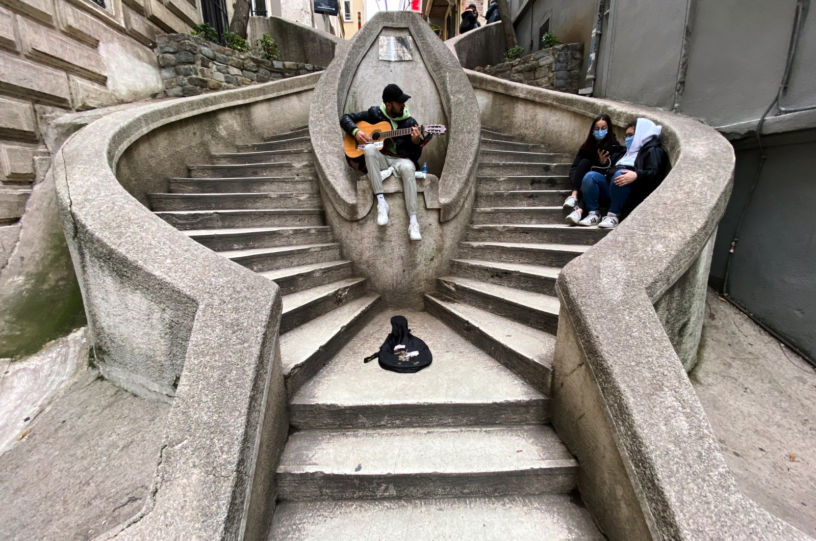 A musician performs at the Camondo Stairs amid the spread of the coronavirus disease (COVID-19), in Istanbul, Turkey on Jan. 12, 2021. (Reuters Photo)