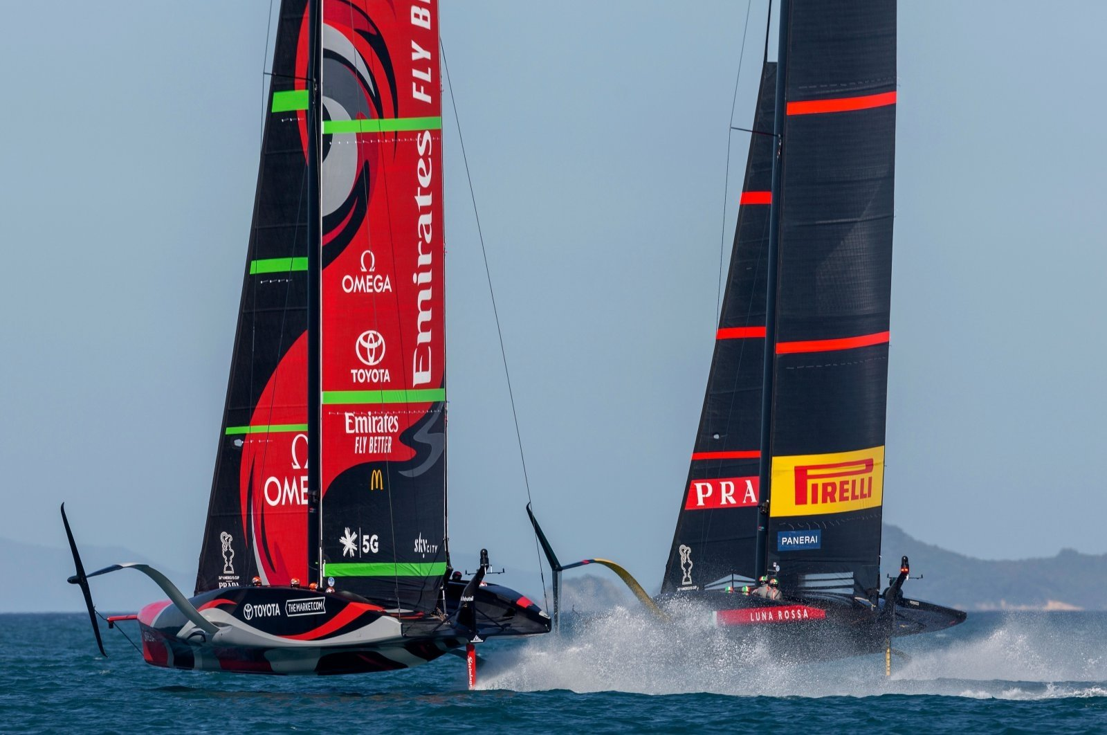 Luna Rossa Prada Pirelli (R) competes against Emirates Team New Zealand on practice racing day, in Auckland, New Zealand, Dec. 15, 2020. (AFP Photo)
