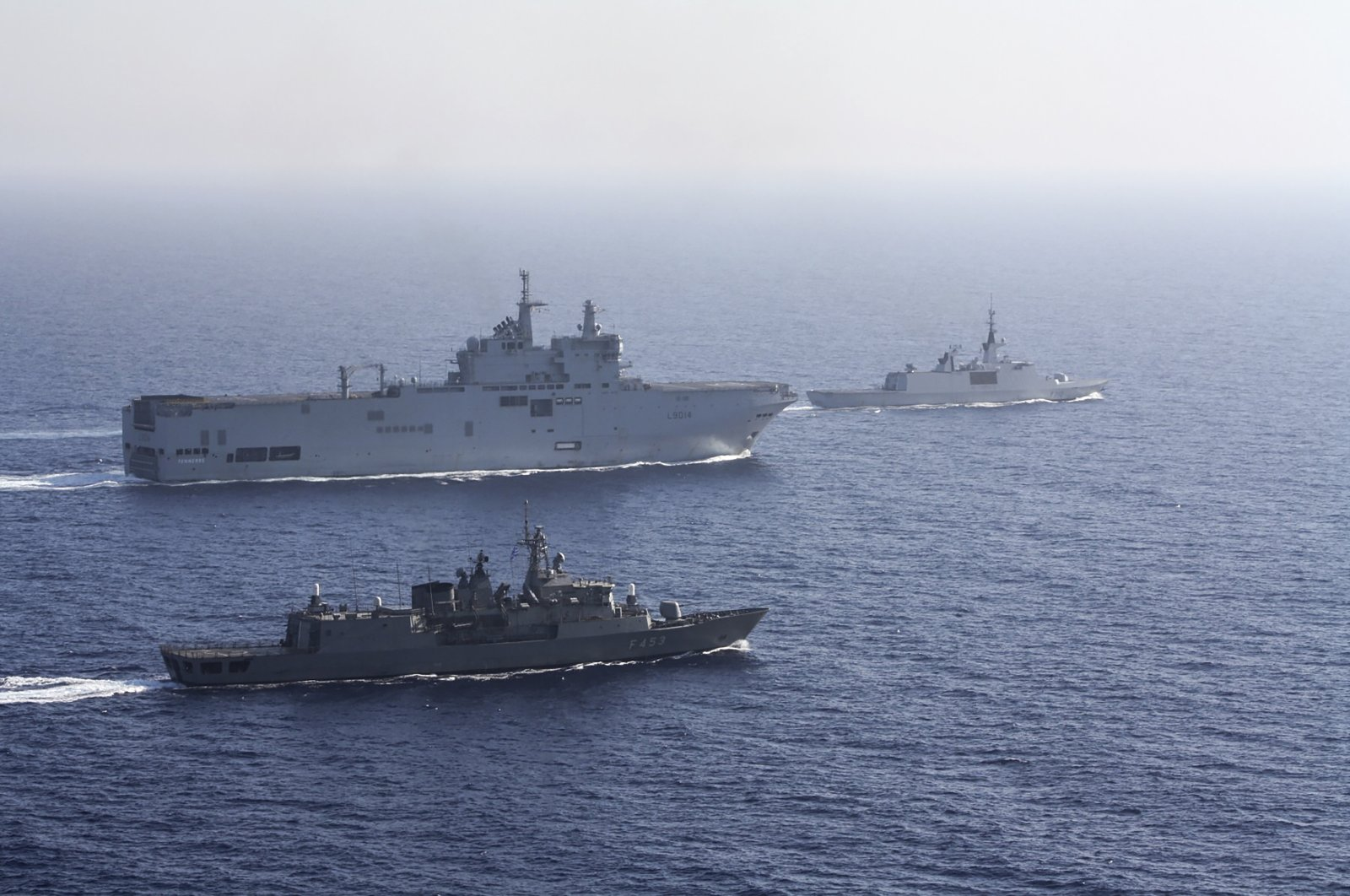 A French Tonnerre helicopter carrier (rear L) is escorted by Greek and French military vessels during a maritime exercise in the Eastern Mediterranean, Aug. 13, 2020. (AP Photo)