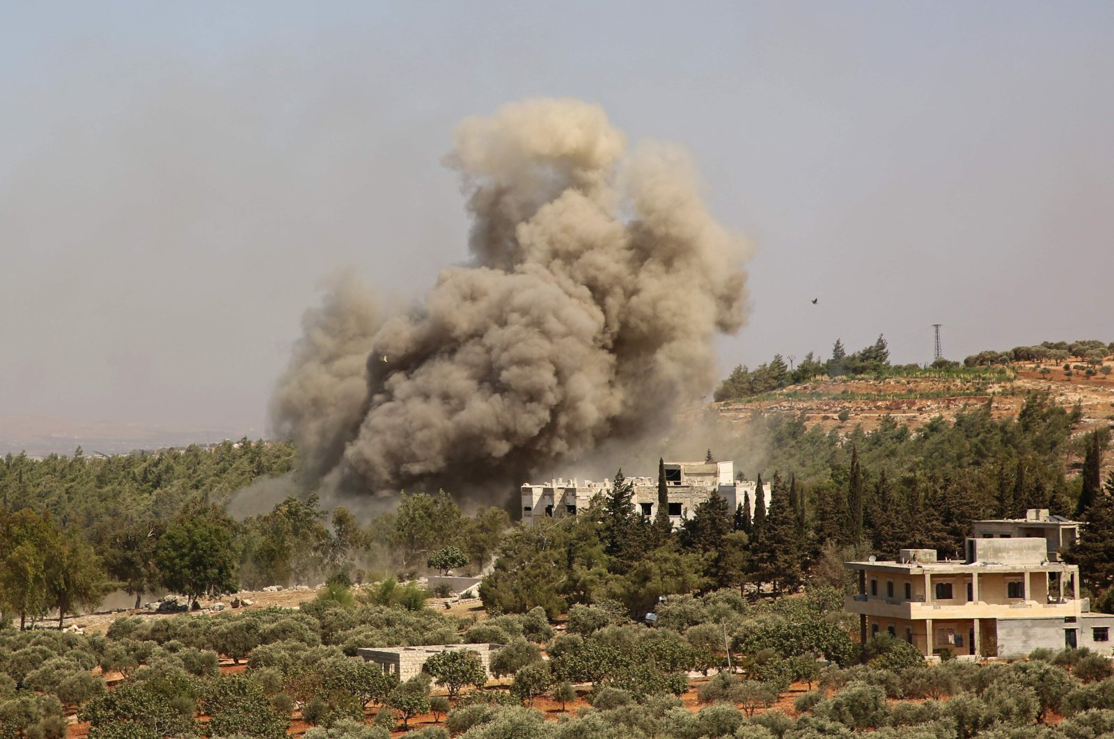 In this file photo, smoke billows following a reported airstrike on the western outskirts of the Syrian province of Idlib, Sept. 20, 2020. (AFP Photo)