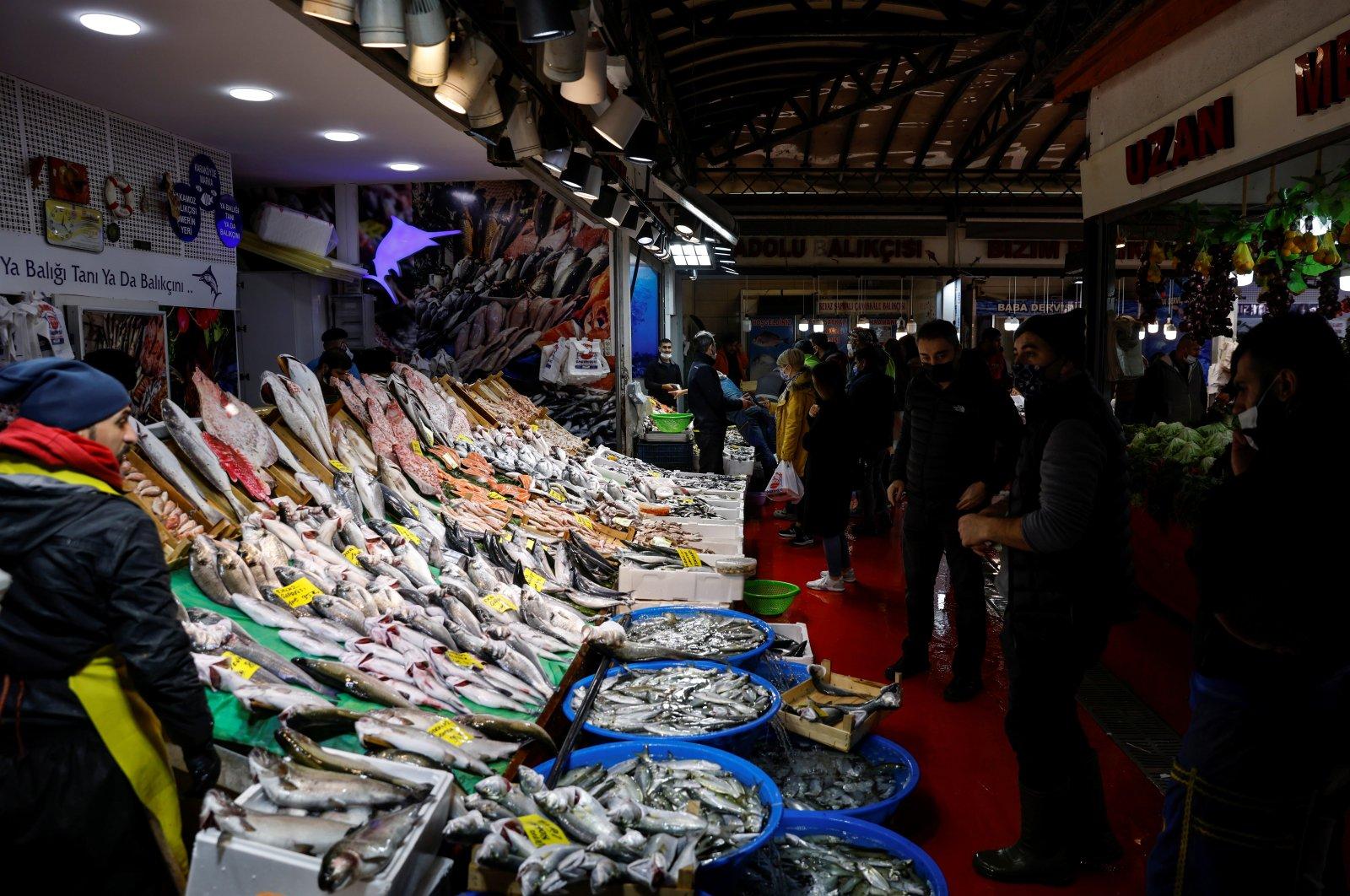 People shop at a fish market in Istanbul's Karaköy district, Turkey, Jan. 8, 2021. (Reuters Photo)