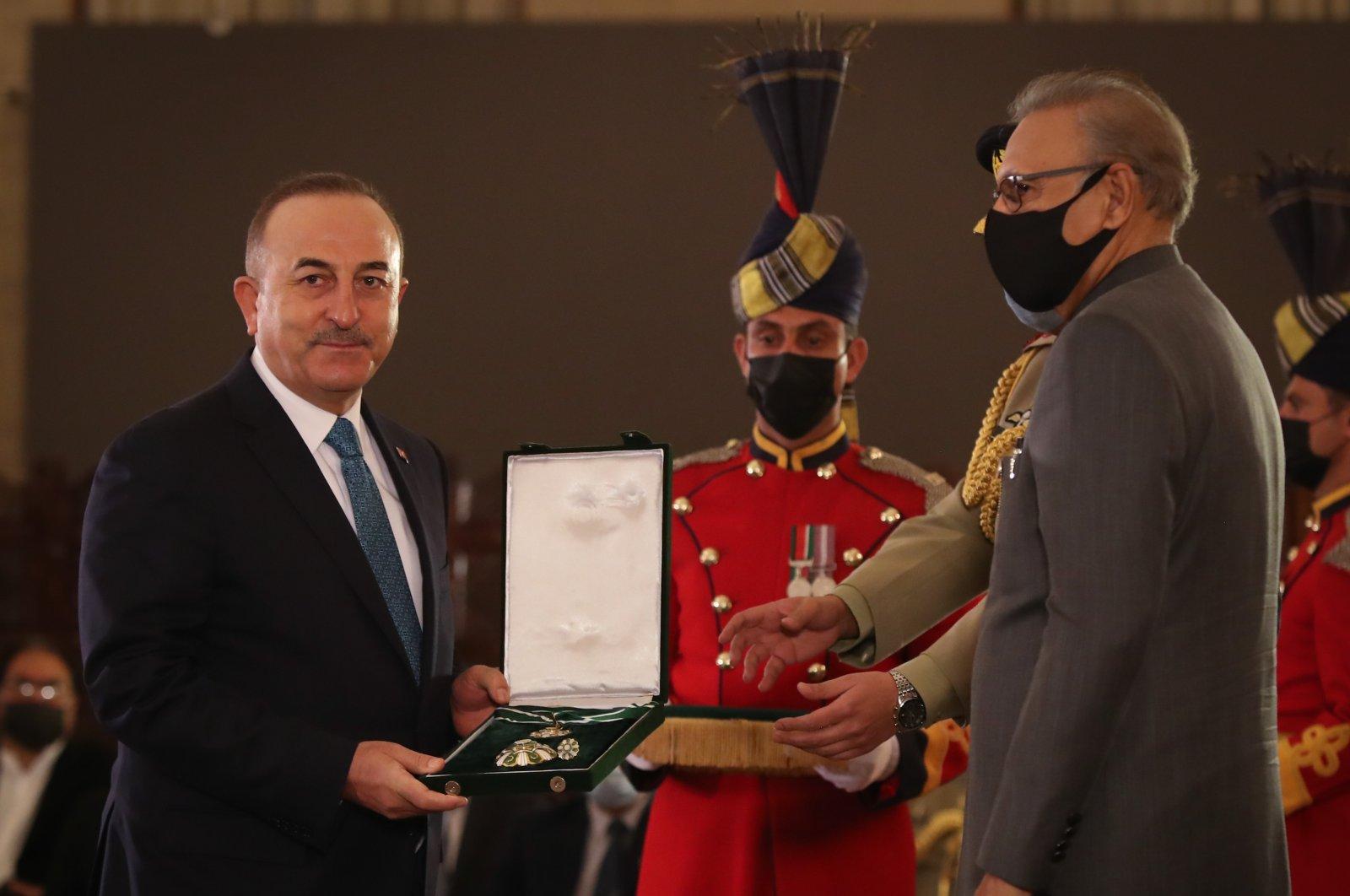 Foreign Minister Mevlüt Çavuşoğlu receives the Hilal-e Pakistan Award in Islamabad, Pakistan, Jan.13, 2021. (AA)