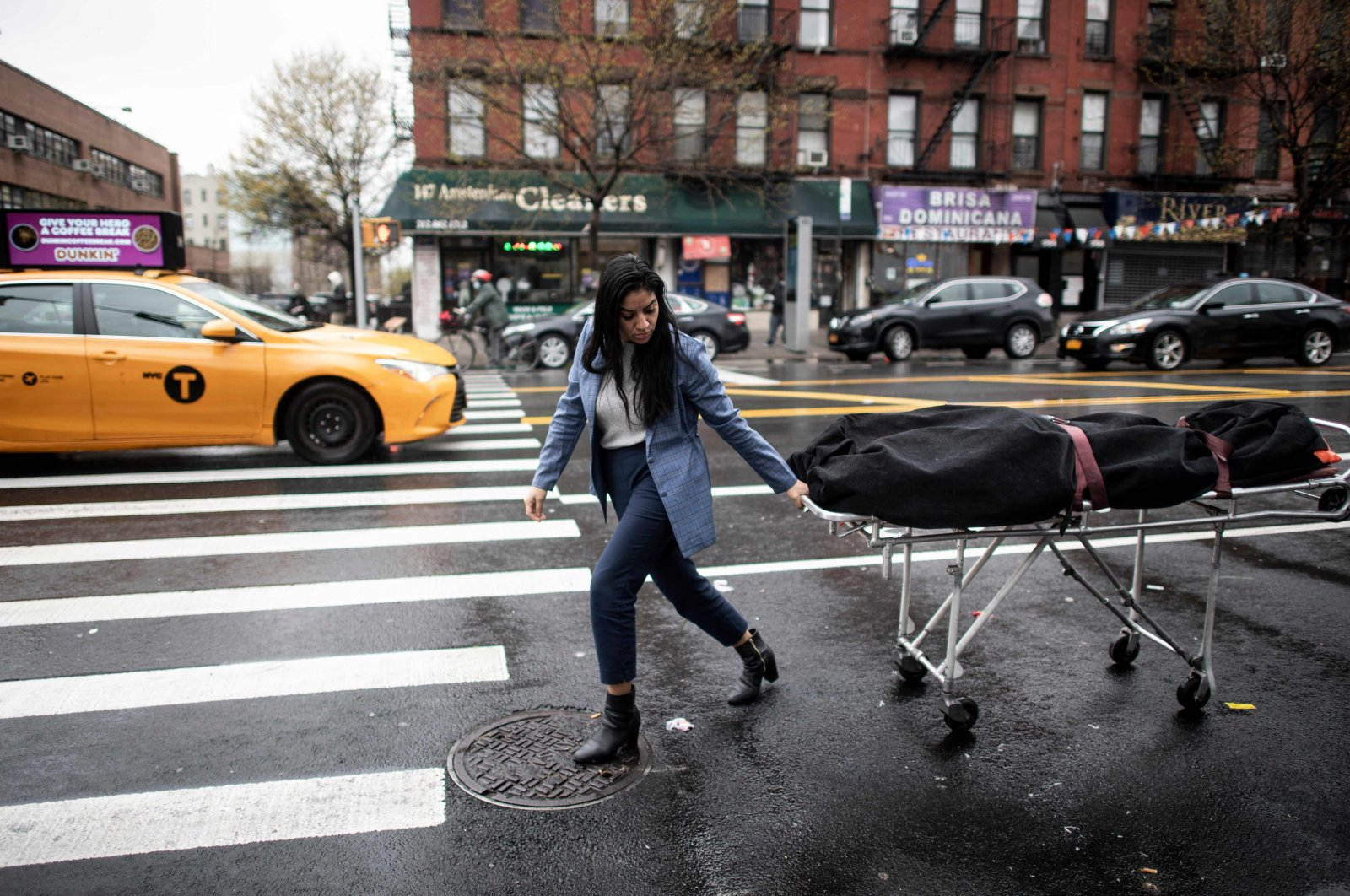 Alisha Narvaez Manager at International Funeral & Cremation Services transports a body to the funeral home in the Harlem neighborhood of New York City, New York, U.S., April 24, 2020. (AFP Photo)
