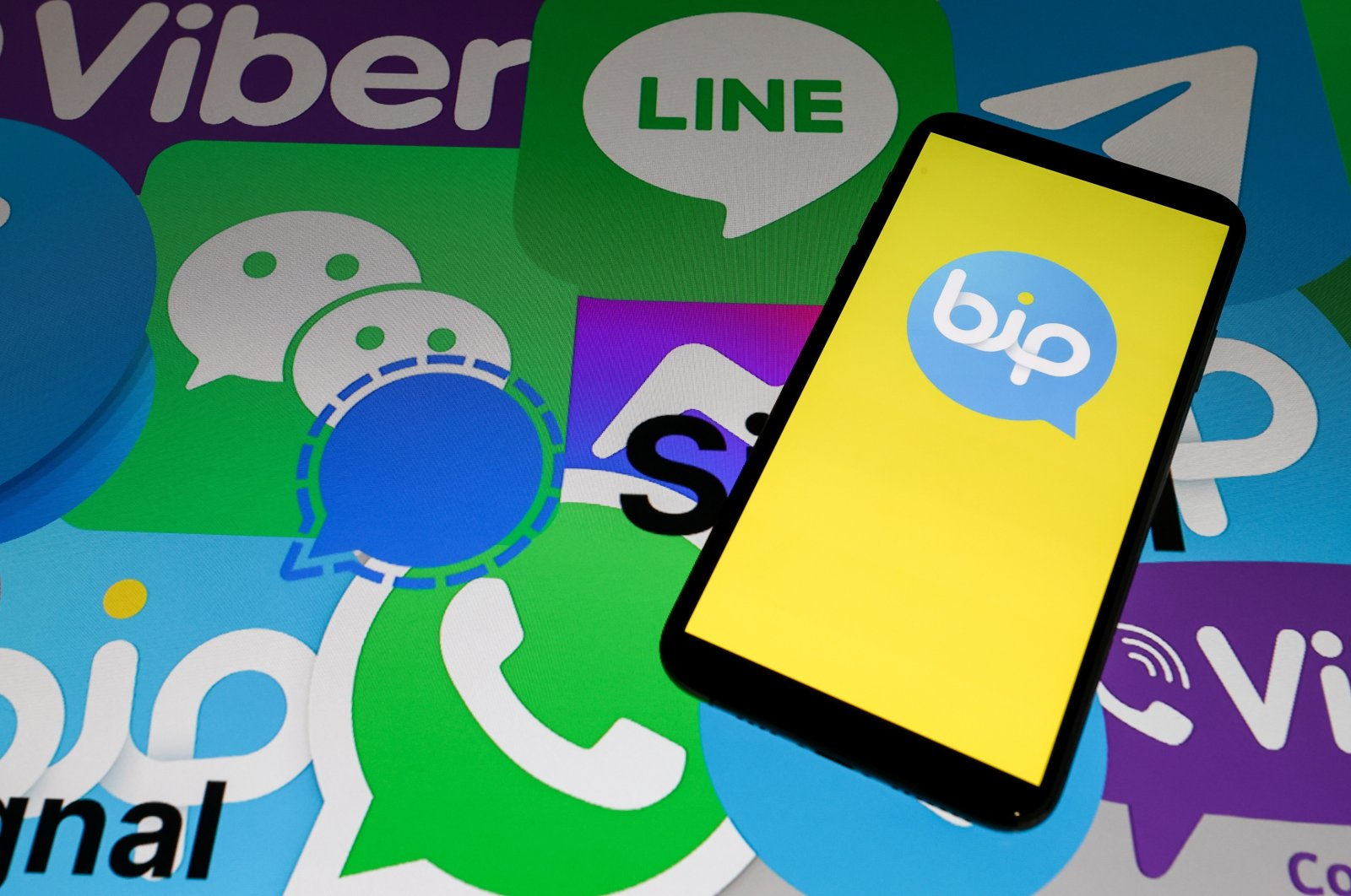 Logos of Turkish messaging app BiP and other apps are seen in this Anadolu Agency illustration created Jan. 10, 2021. (AA Photo)