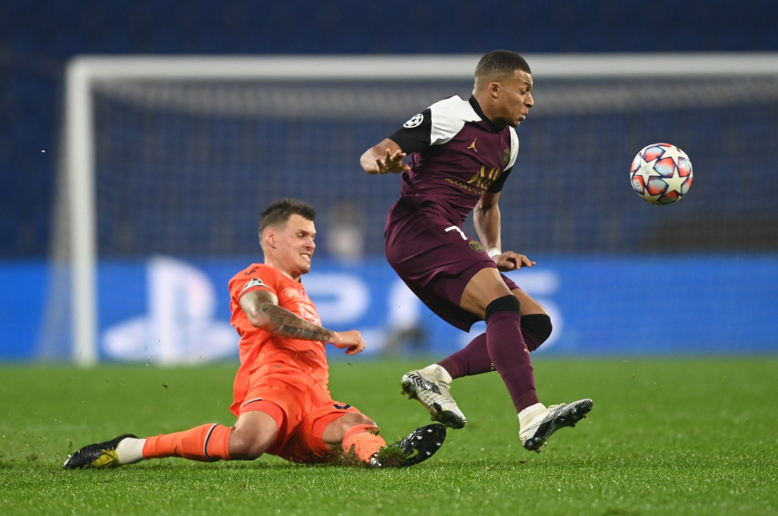Istanbul Başaksehir's Martin Skrtel in action with Paris Saint-Germain's Kylian Mbappe in a Champions League Group H game, in Istanbul, Turkey, Oct. 28, 2020. (Reuters Photo)