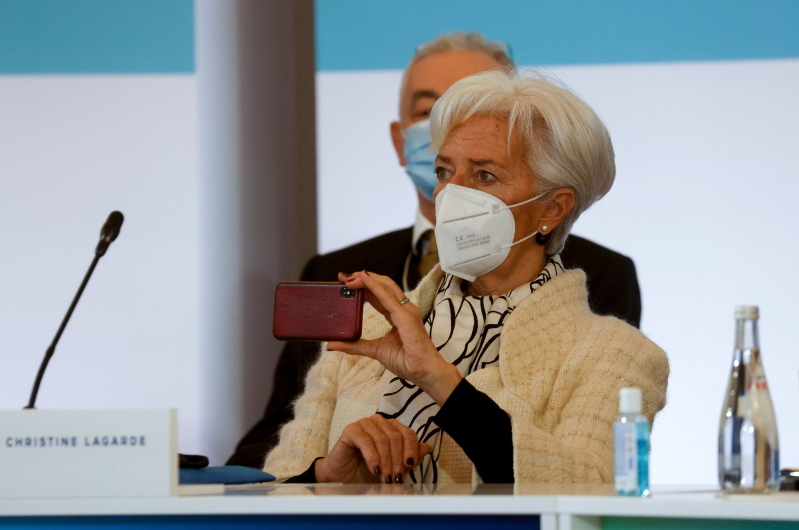 """President of the European Central Bank (ECB) Christine Lagarde holds her smartphone as she attends the """"One Planet Summit"""" on biodiversity which is part of the World Nature Day at The Elysee Palace in Paris, France, Jan. 11, 2021. (Reuters Photo)"""