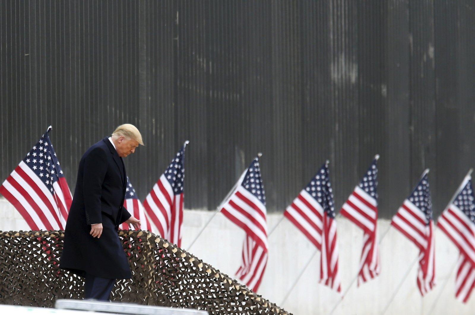 President Donald Trump walks down the steps before a speech near a section of the U.S.-Mexico border wall, Alamo, Texas on Jan. 12, 2021. (AP Photo)
