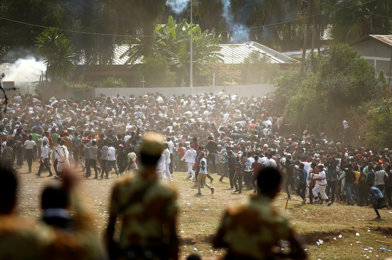 Protestors run from tear gas launched by security personnel during the Irecha, the thanksgiving festival of the Oromo people in Bishoftu town of Oromia region, Ethiopia, Oct. 2, 2016. (Reuters Photo)