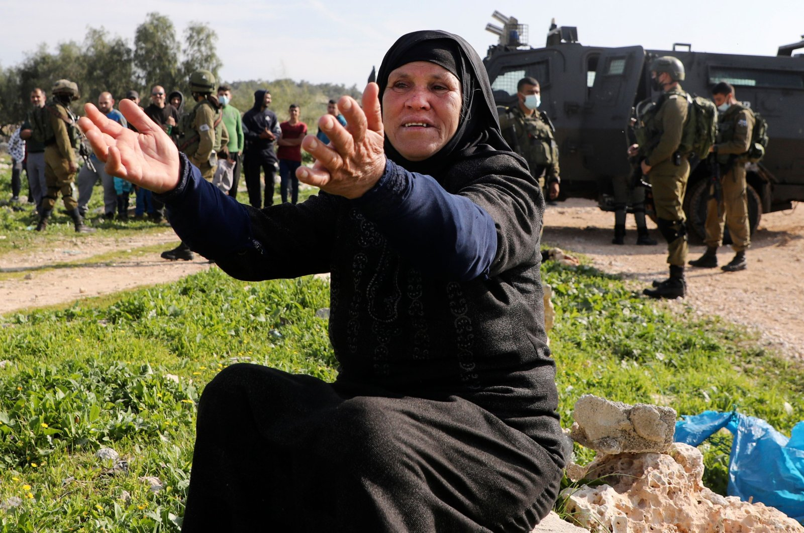 Palestinian farmers protest after Israeli security forces uprooted olive trees reportedly located within Area C in the occupied West Bank village of Deir Ballut, Palestine, Jan. 6, 2021. (AFP Photo)