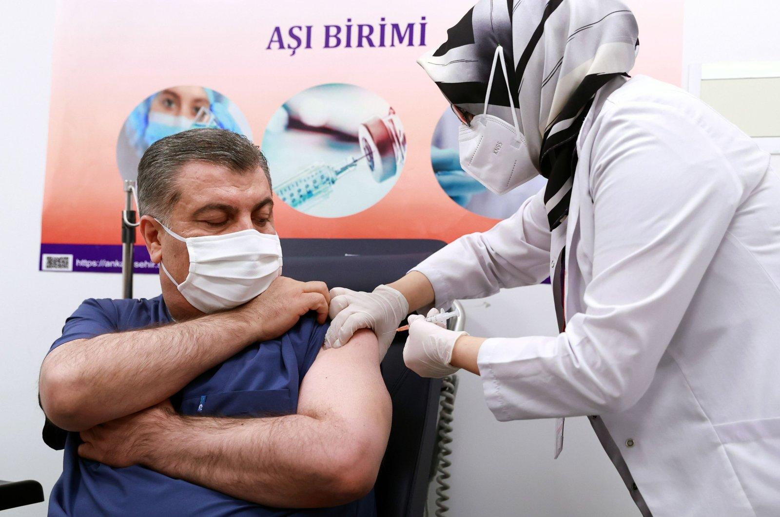 Turkey's Health Minister Fahrettin Koca receives a dose of Sinovac's COVID-19 vaccine at Ankara City Hospital, in Ankara, Turkey, Jan. 13, 2021. (AFP Photo)
