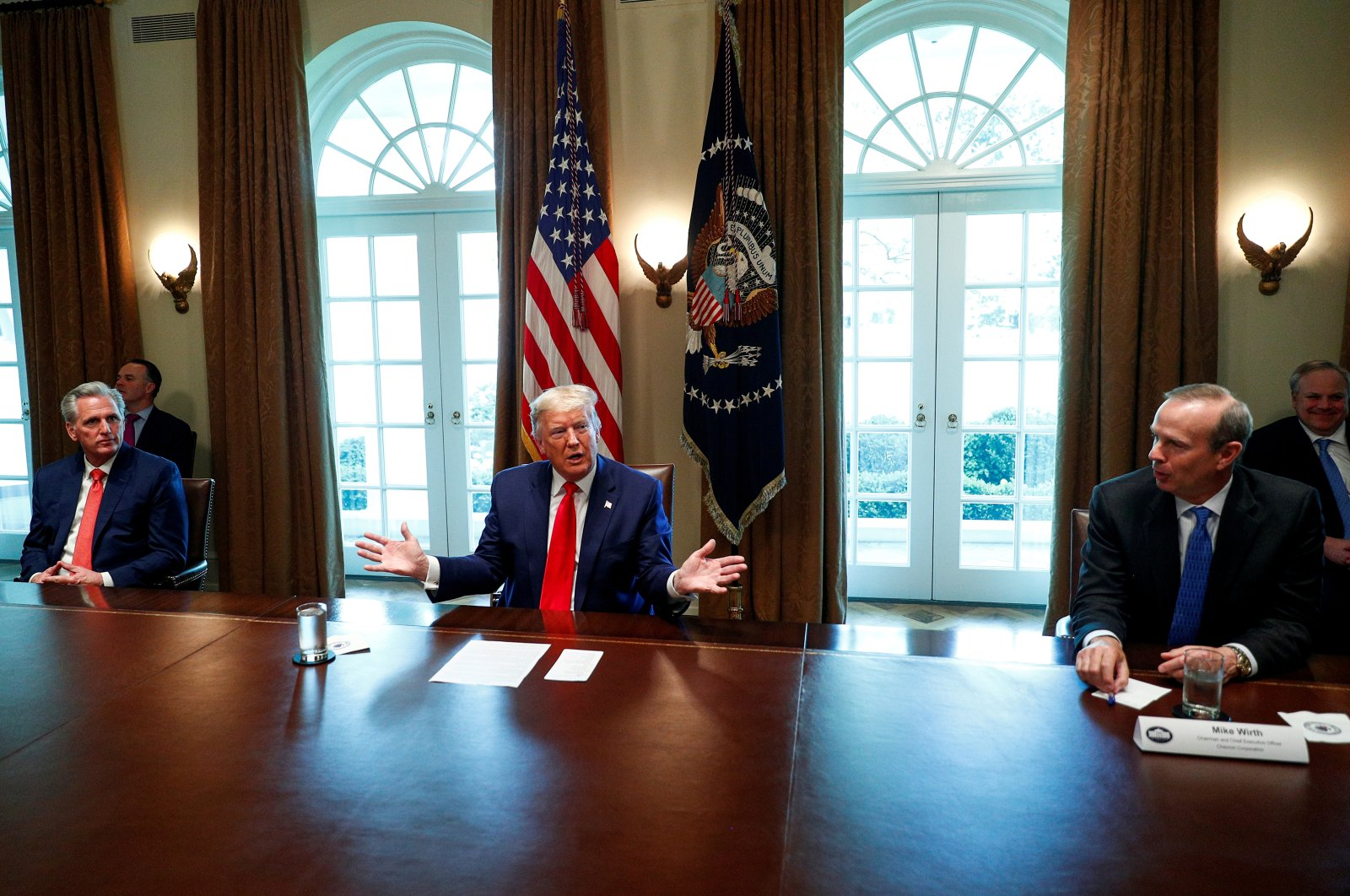 U.S. President Donald Trump speaks during a roundtable with energy sector CEOs as House Minority Leader Kevin McCarthy (R-CA) and Chevron CEO Mike Wirth listen in the Cabinet Room of the White House in Washington, U.S., April 3, 2020. (Reuters File Photo)