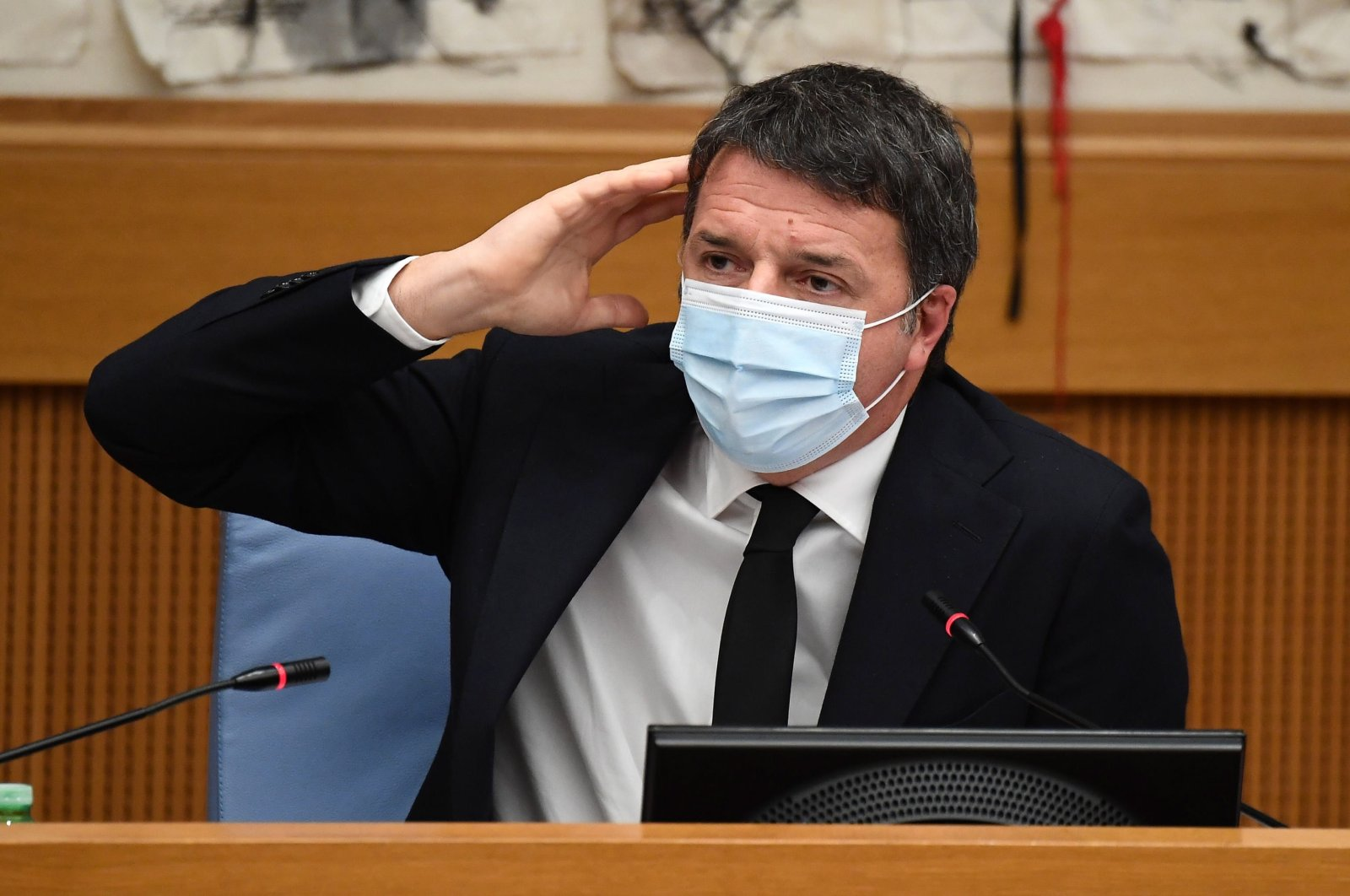 Leader of Italia Viva party Matteo Renzi gestures during a press conference in the group room of the Chamber of Deputies in Rome, Italy, Jan. 13, 2021. (EPA Photo)