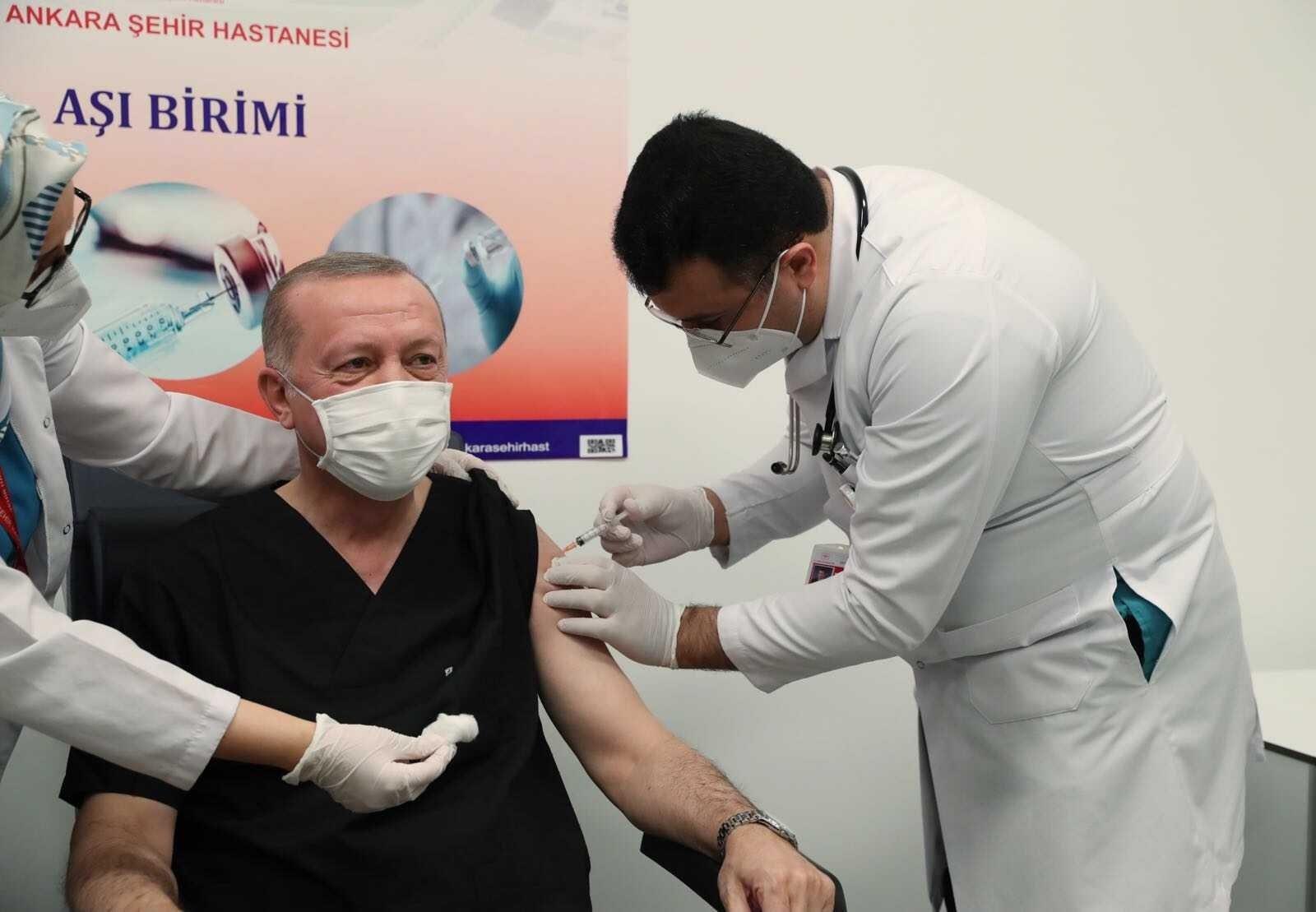 President Recep Tayyip Erdoğan receives the first dose of Sinovac's COVID-19 vaccine at Ankara City Hospital in Turkey's capital Ankara, Jan. 14, 2021.