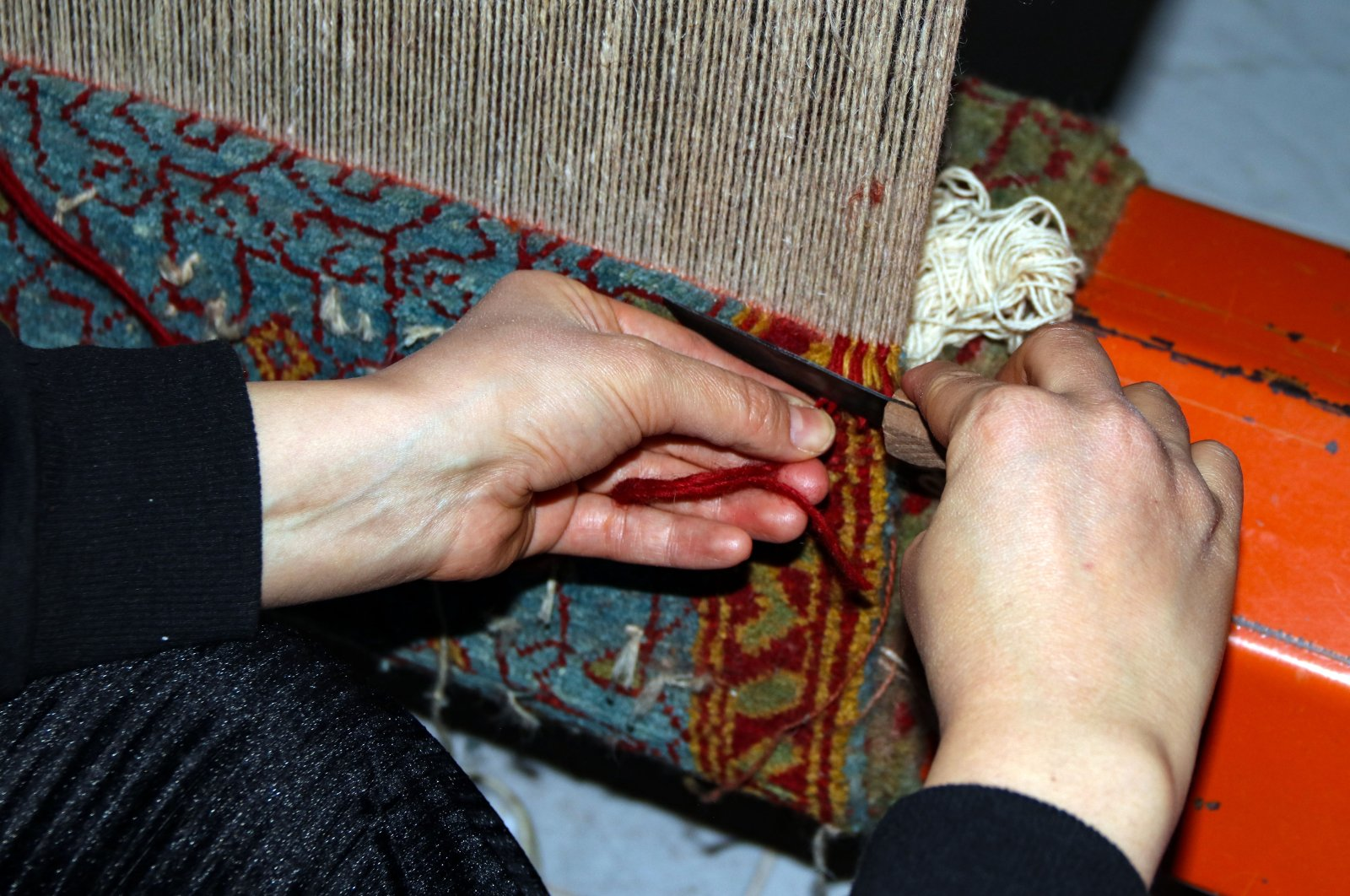 A close-up of the hands of a local woman weaving a carpet at the workshop in Iğdır, eastern Turkey, Jan. 13, 2021. (AA Photo)