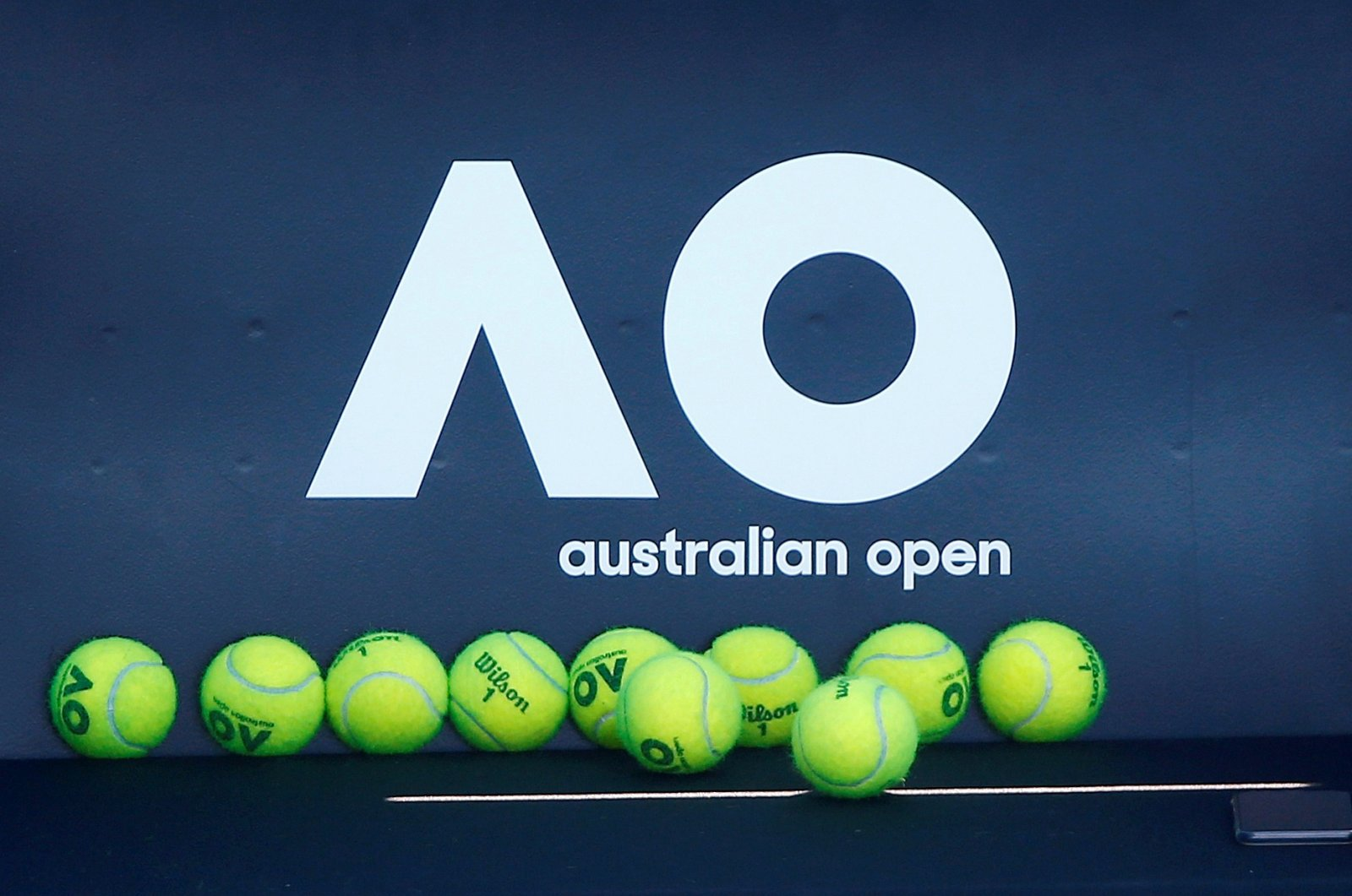 Tennis balls are pictured in front of the Australian Open logo before the tennis tournament, in Melbourne, Australia, Jan. 14, 2018. (Reuters Photo)