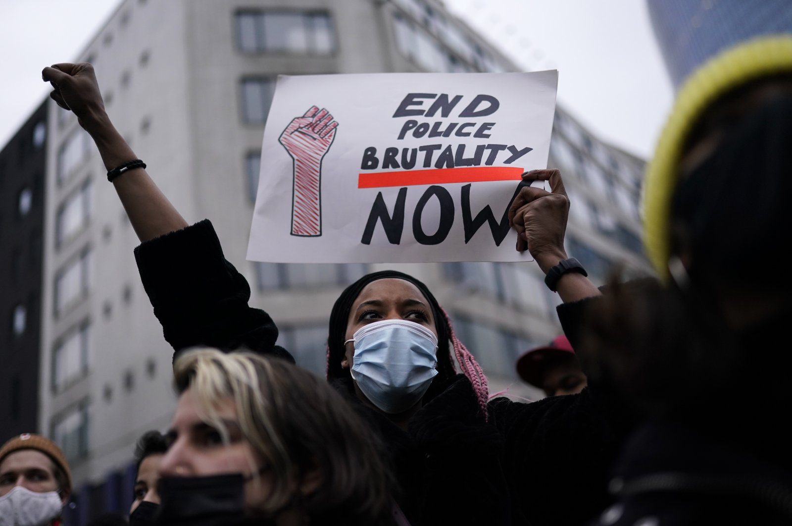 Protesters shout slogans in the capital Brussels, Belgium, Jan. 13, 2021. (AP Photo)