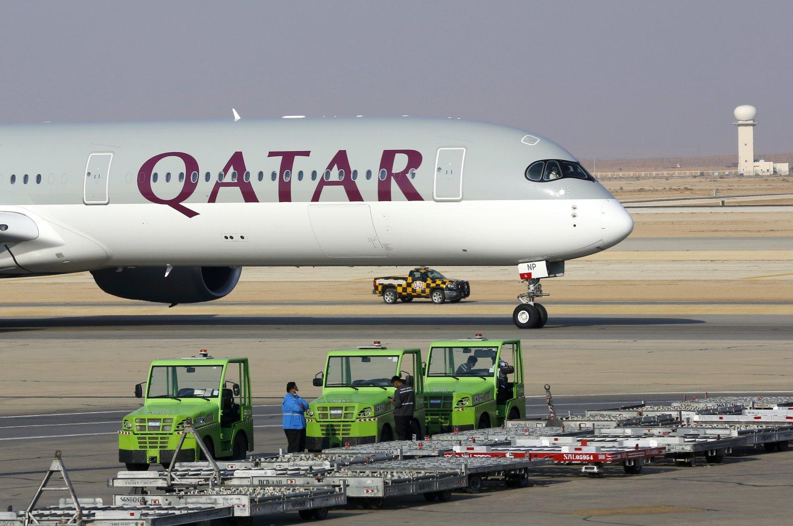 The first Qatar Airways plane in three years to land at King Khalid Airport in Riyadh, Saudi Arabia, Jan. 11, 2021. (AP Photo)