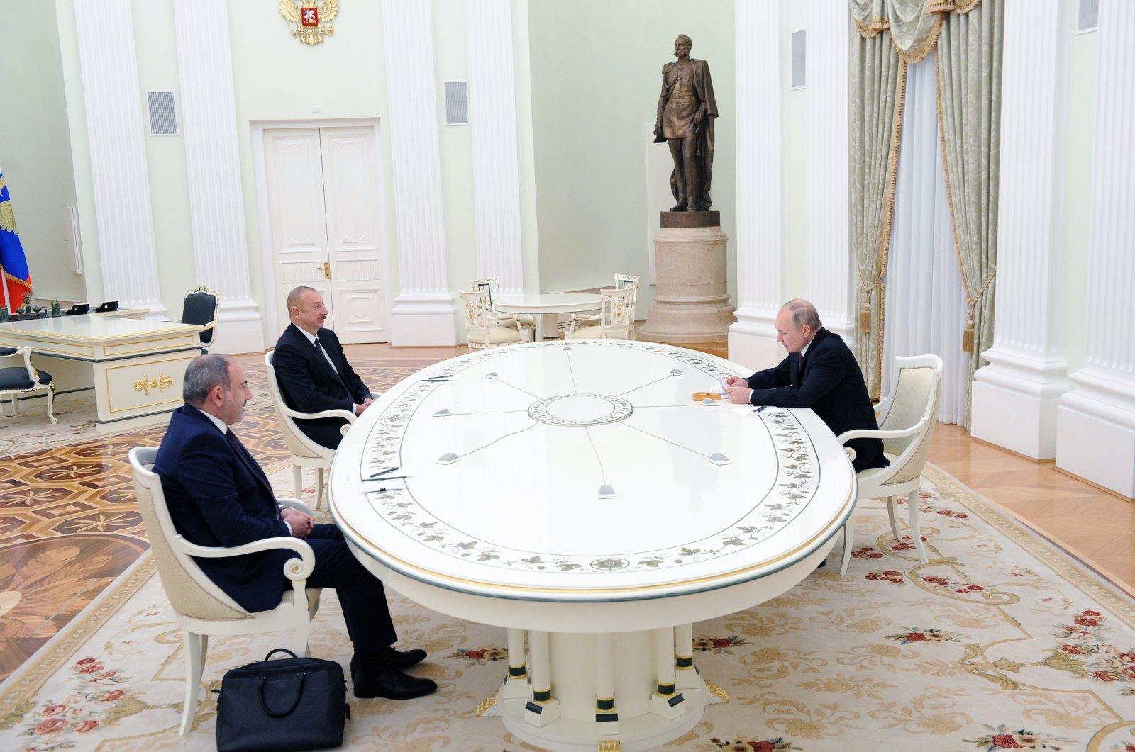 Armenian Prime Minister Nikol Pashinyan (L), Azerbaijan's President Ilham Aliyev (C) and Russian President Vladimir Putin attend a meeting in Moscow, Russia, Jan. 11, 2021. (AP Photo)