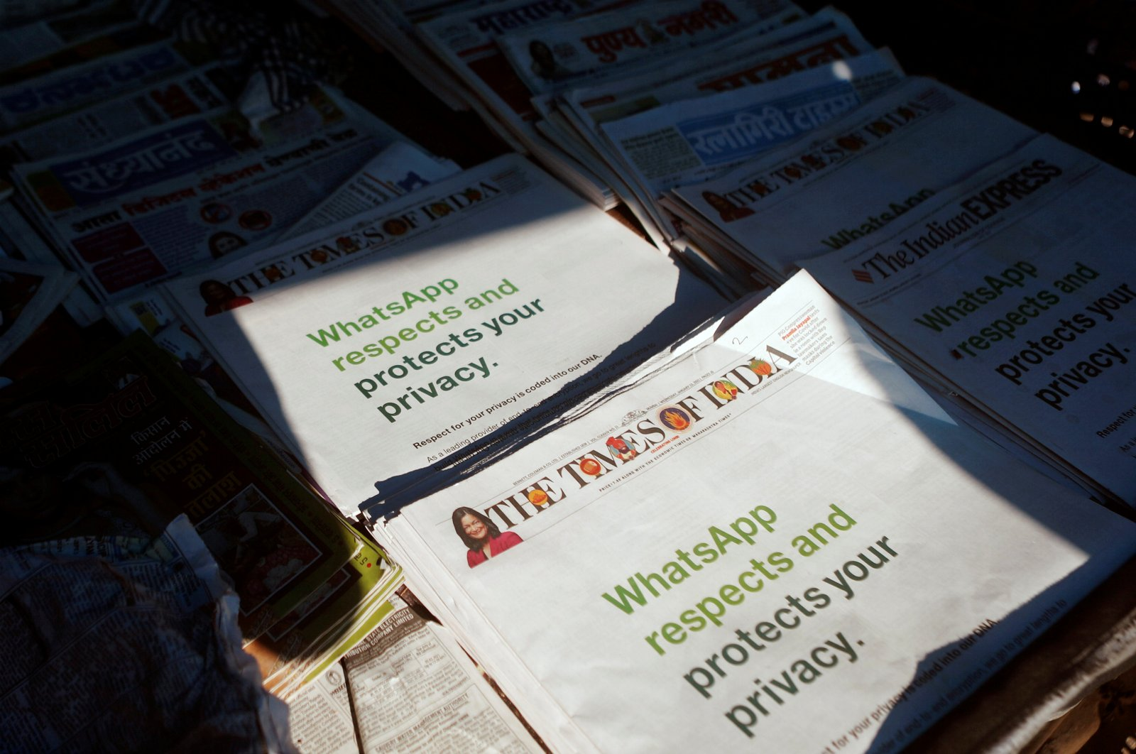 A WhatsApp advertisement is seen on the front pages of newspapers at a stall in Mumbai, India, Jan. 13, 2021. (Reuters Photo)