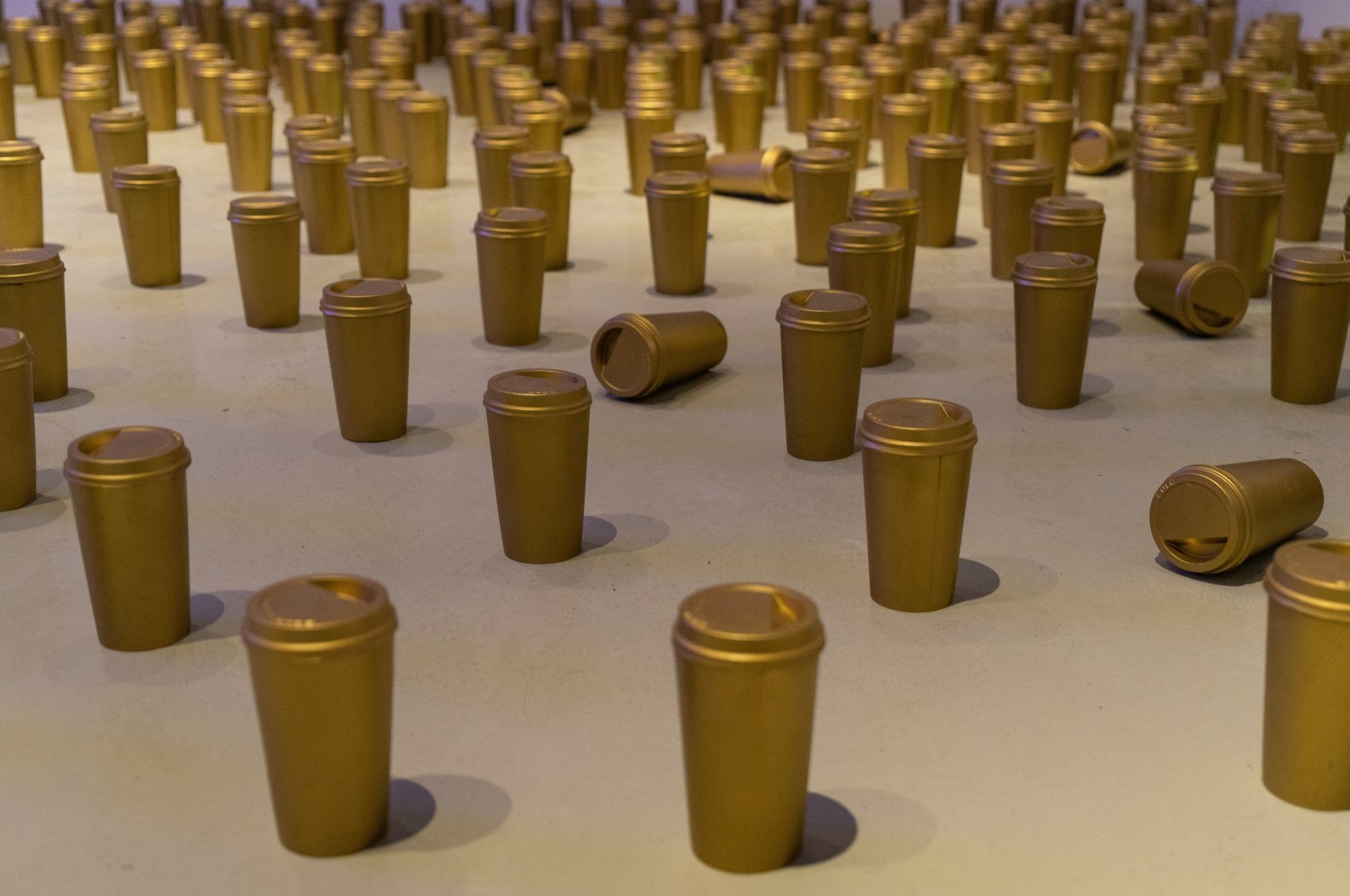 "Fırat Engin, ""Invasion,"" 2011, installation, polyester coffee cups, acrylic."