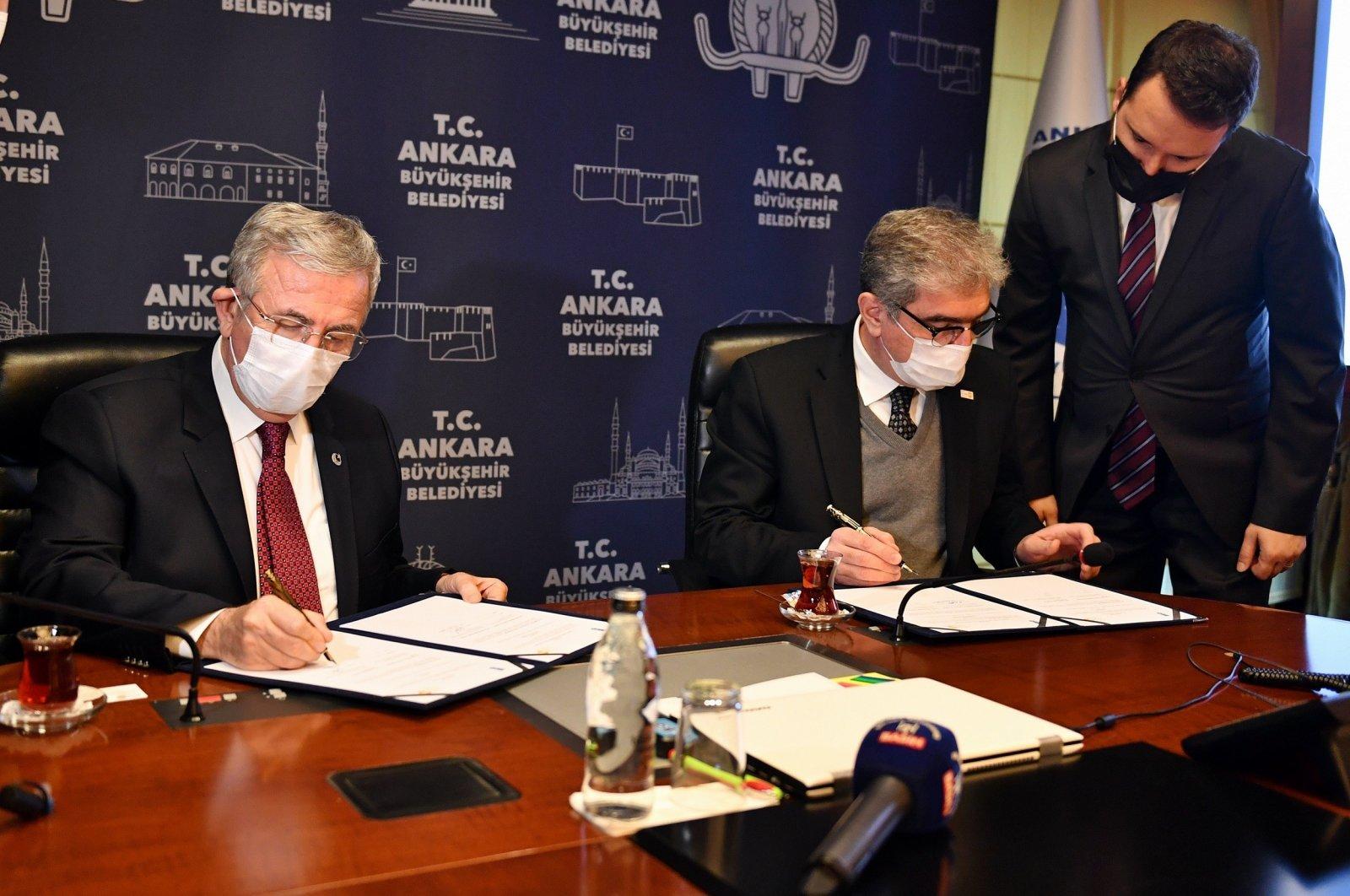 Ankara Mayor Mansur Yavaş (L) and UNFPA Representative Hassan Mohtashami signed the protocol in the capital Ankara, Turkey, Jan. 14, 2021. (IHA Photo)