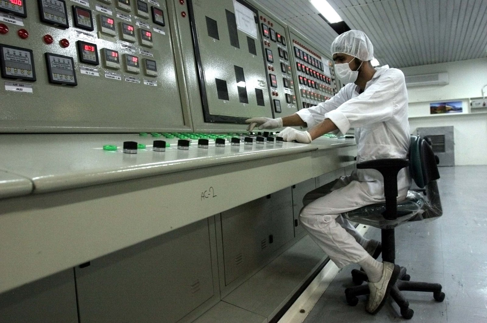 A technician works at the Uranium Conversion Facility just outside the city of Isfahan, Iran, 255 miles (410 kilometers) south of the capital Tehran, Feb. 3, 2007. (AP Photo)