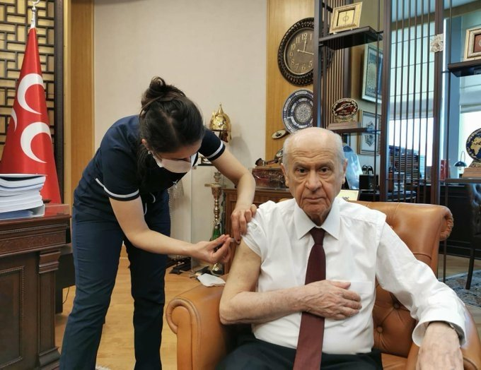 MHP Chairperson Bahçeli receives the first doze of CoronaVac at his party's headquarters in Ankara on Friday, Jan. 15, 2020 (AA Photo)