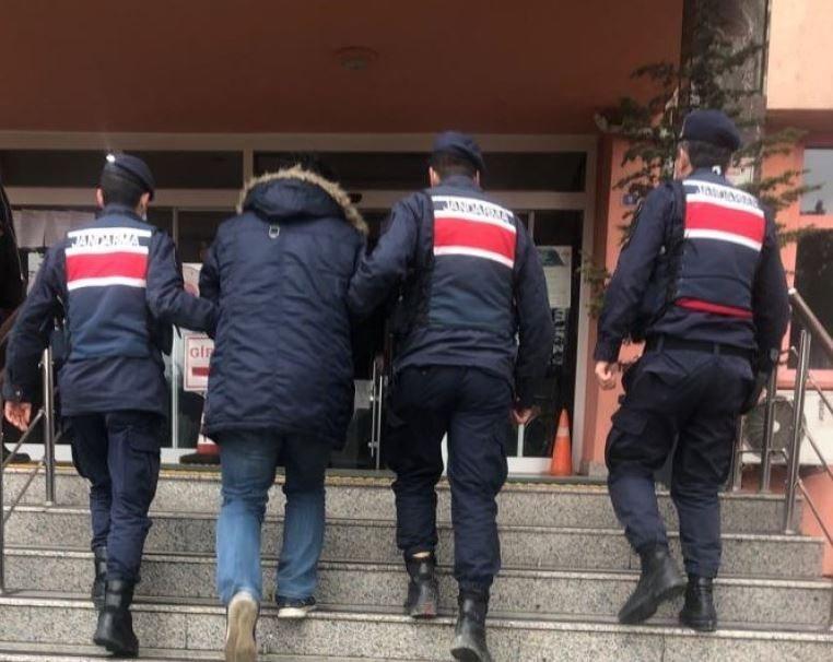 Gendarme officers escort a FETÖ suspect detained in Karabük, northern Turkey, Jan. 15, 2021. (AA Photo)