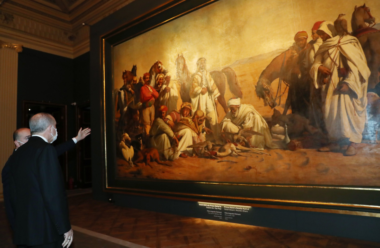 President Recep Tayyip Erdoğan looks at Felix-Auguste Clement's