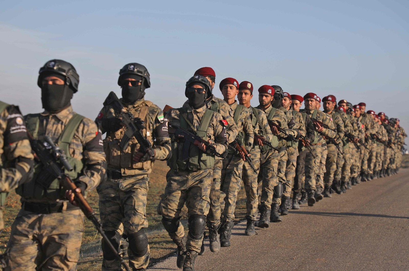 Turkey-backed Syrian National Army (SNA) soldiers take part in a military exercise in Ghandoura, in the countryside northeast of Aleppo, Syria, Jan. 14, 2021. (AFP Photo)