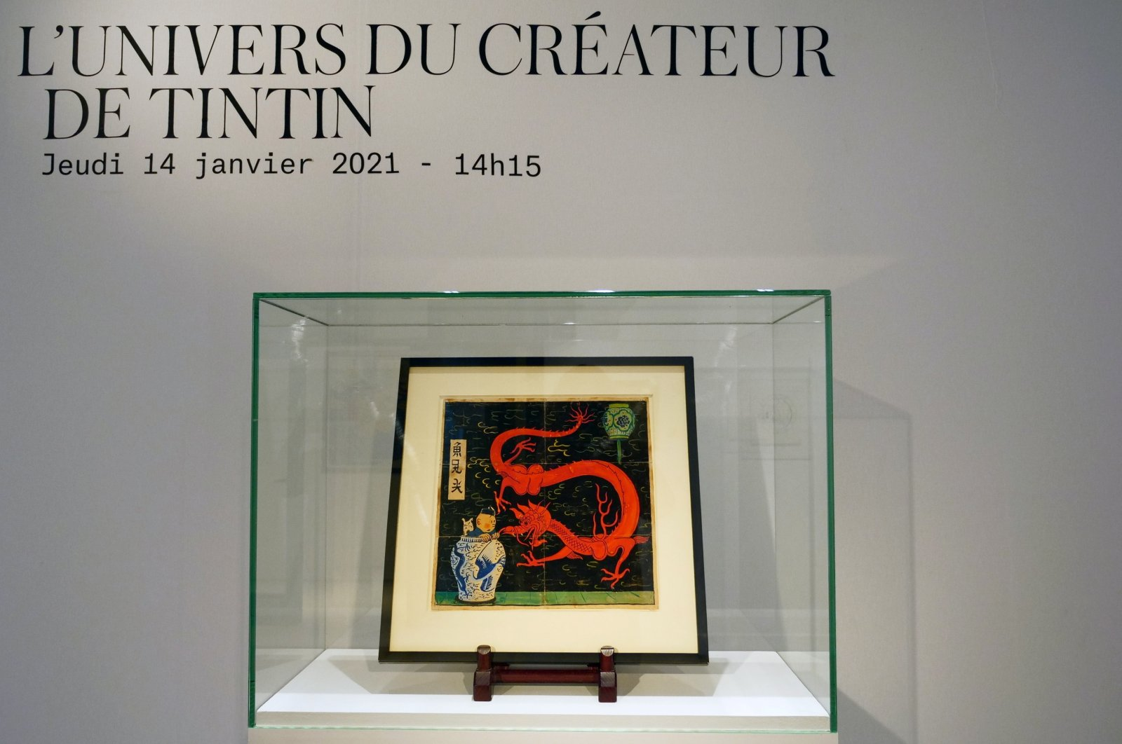 """Painting for the original cover of """"The Blue Lotus"""" Tintin comic book (1936) is displayed before being auctioned by Artcurial in Paris, France on Jan. 13, 2021. (Reuters Photo)"""