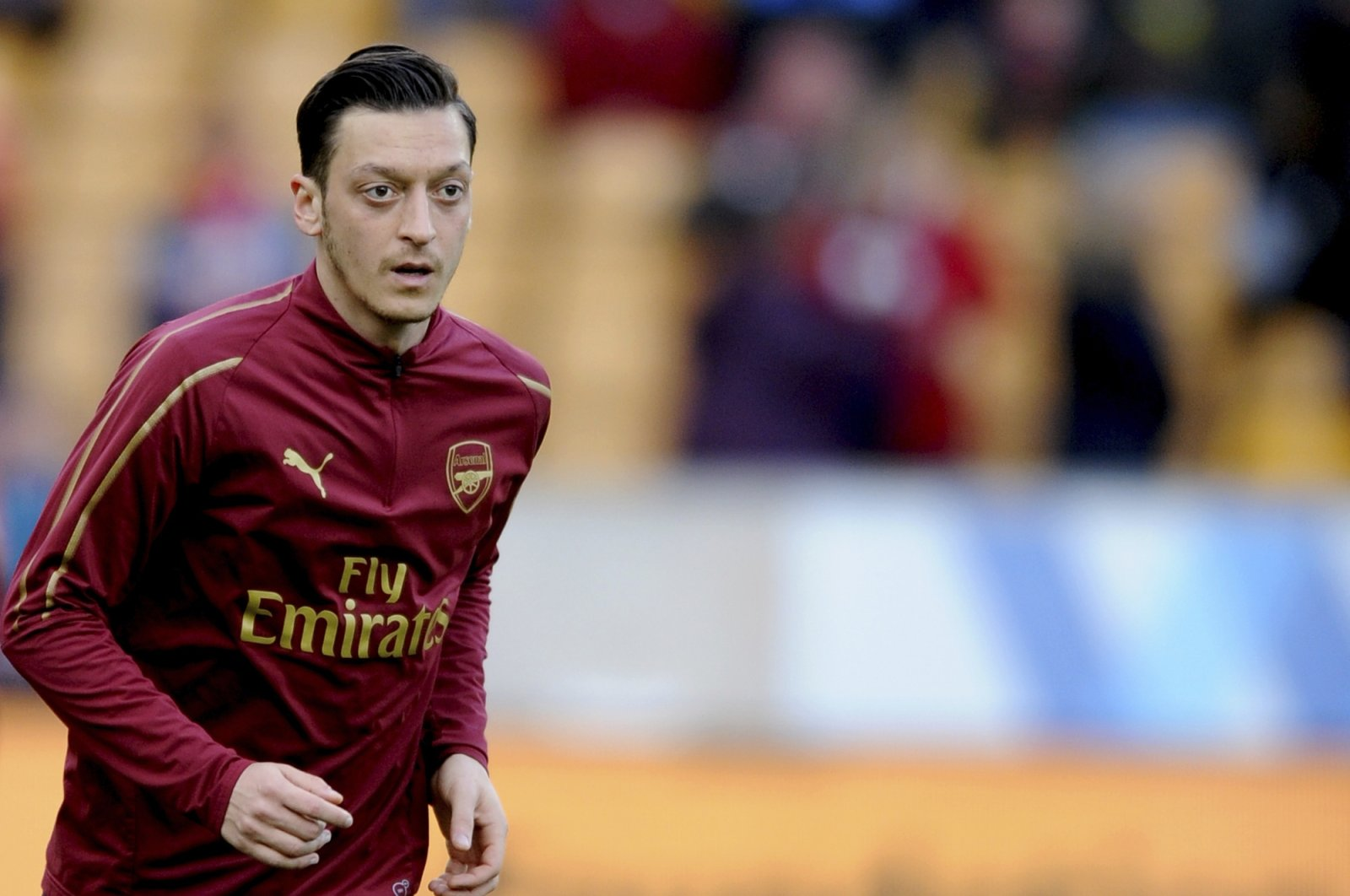 Arsenal's Mesut Özil runs during warmup before a Premier League match against Wolverhampton Wanderers at the Molineux Stadium in Wolverhampton, England, April 24, 2019. (AP Photo)