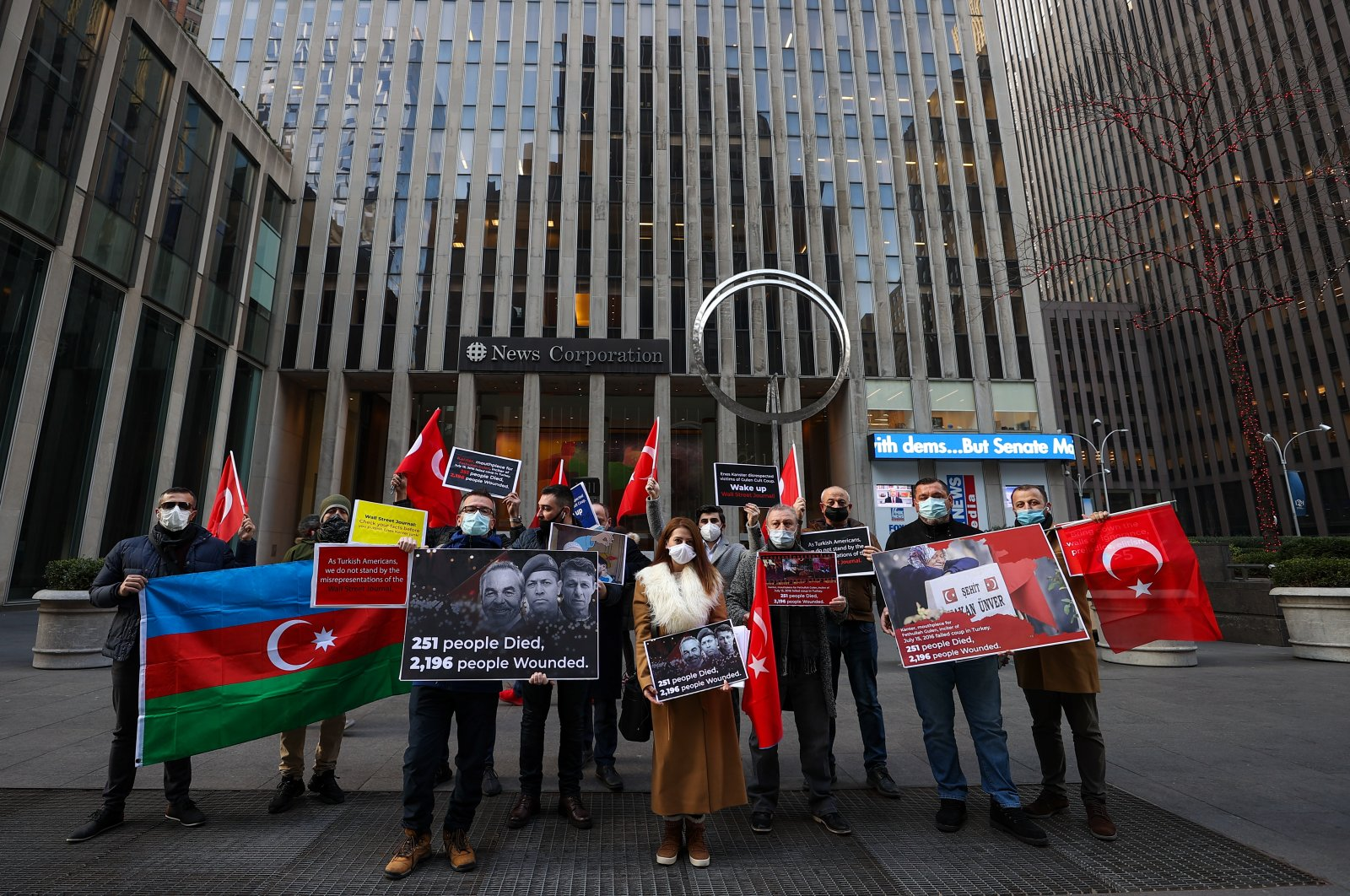 A group of Turkish people protests The Wall Street Journal (WSJ) for providing a platform for Gülenist Terror Group (FETÖ) supporter Enes Kanter, in front of the WSJ headquarters in New York, U.S., Jan. 15, 2021. (AA Photo)