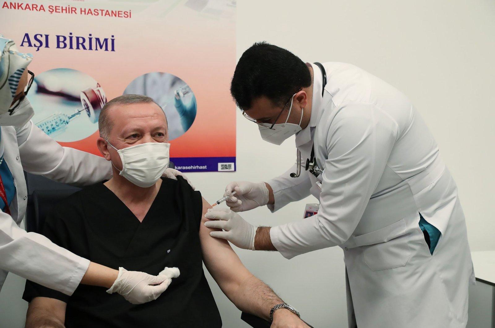 President Recep Tayyip Erdoğan (C) receiving the first dose of the CoronaVac Covid-19 vaccine at Ankara City Hospital in Ankara on Jan. 14, 2021. (Turkish Presidential Press Service Photo)