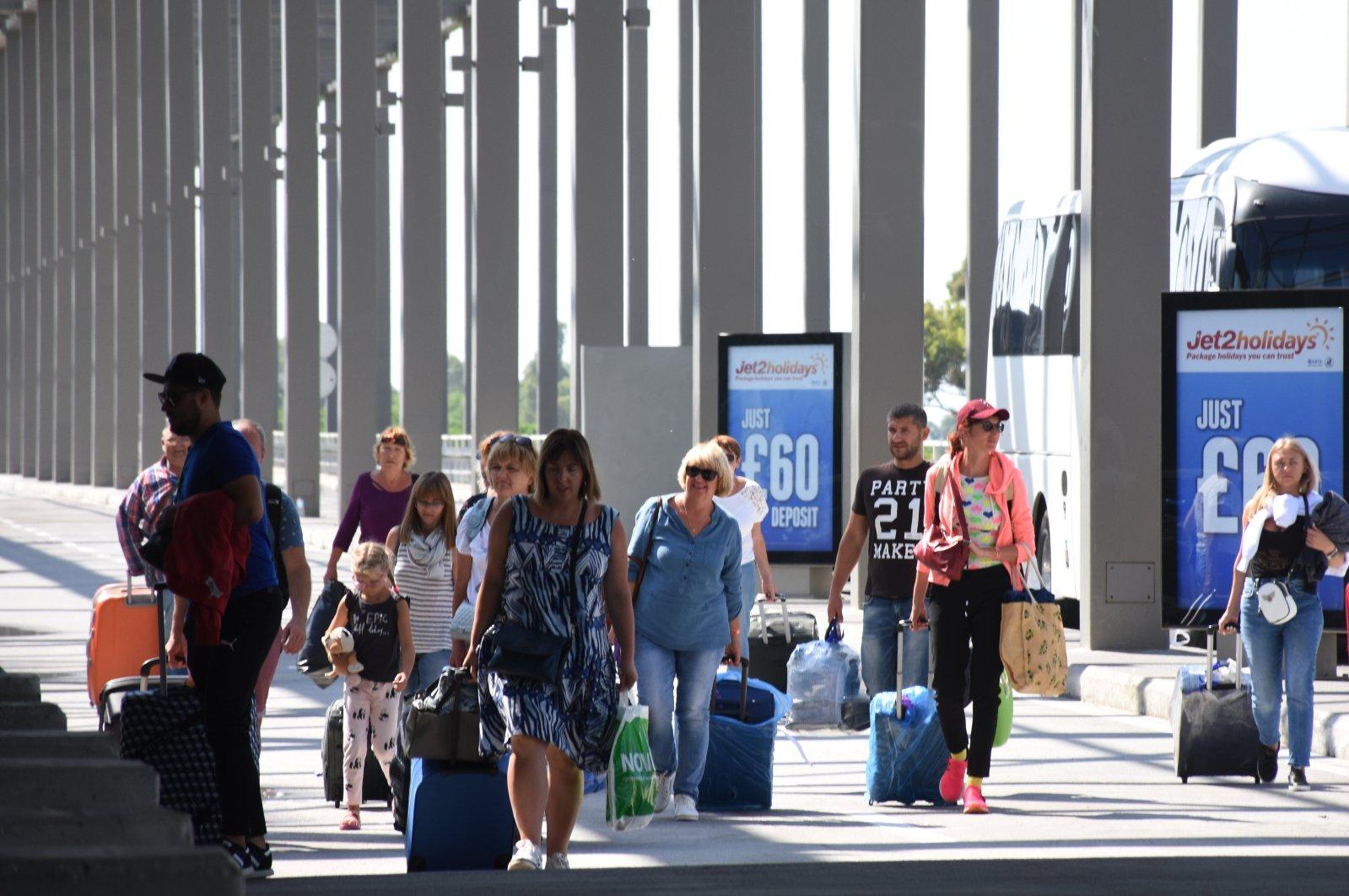 British tourists walk in southwestern Turkey's Dalaman airport, Muğla, Sept. 26, 2019. (AA Photo)