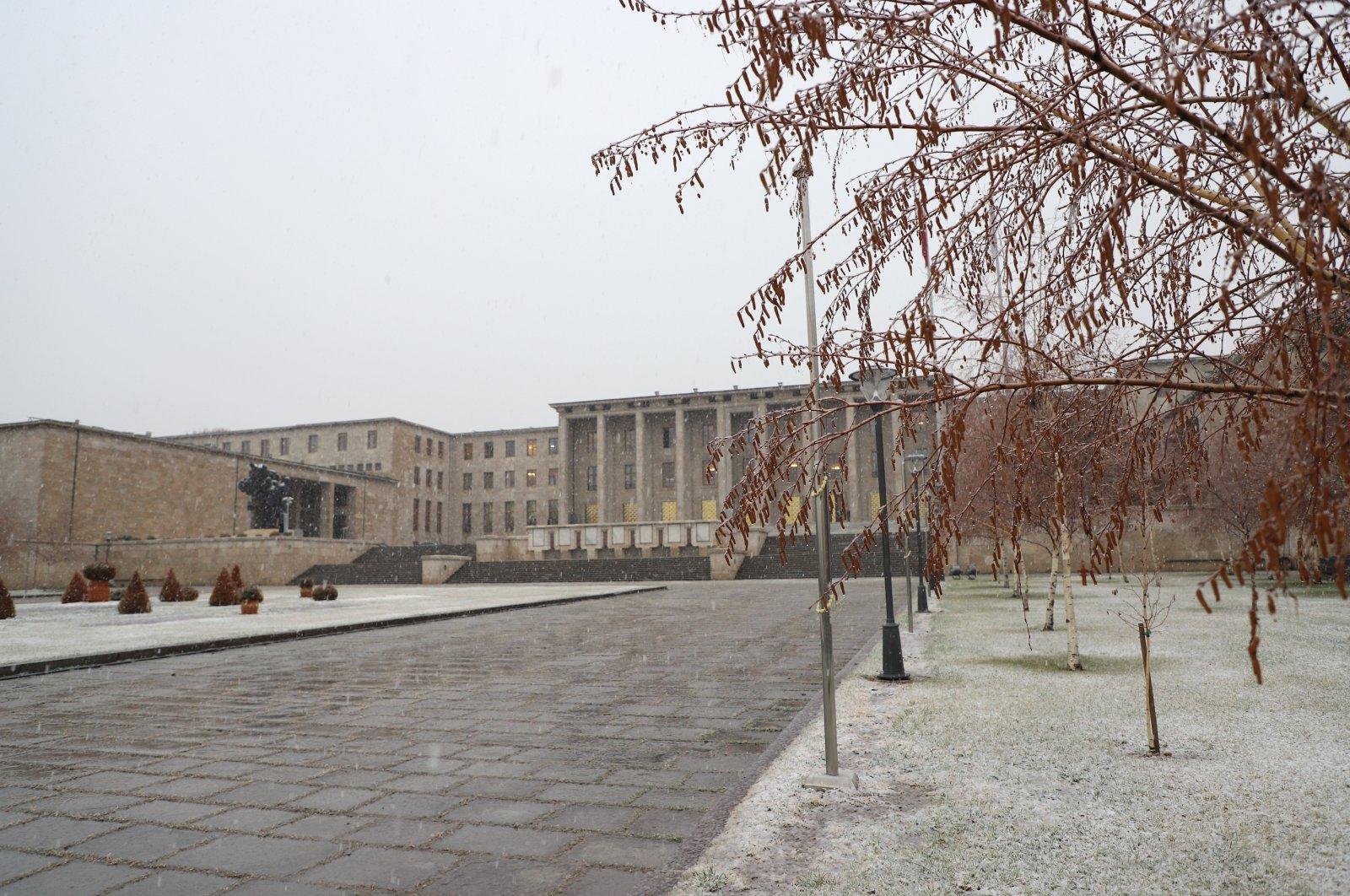 The Turkish Grand National Assembly (TBMM) is seen as snow falls in the capital Ankara, Turkey, Jan. 13, 2021. (AA Photo)