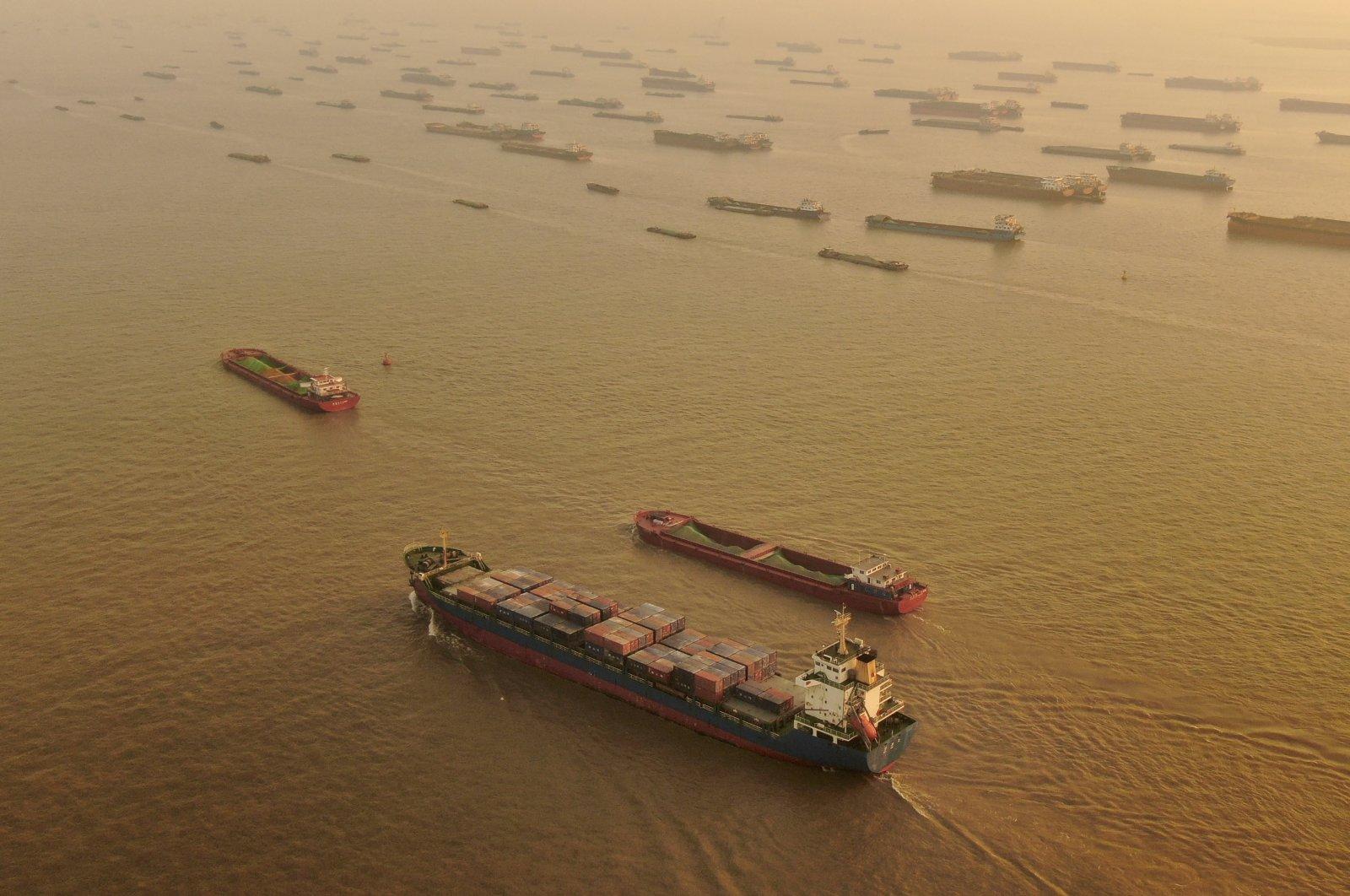 A cargo ship sails along the Yangtze River in Nantong, Jiangsu, China, Jan. 2, 2021. (AP Photo)