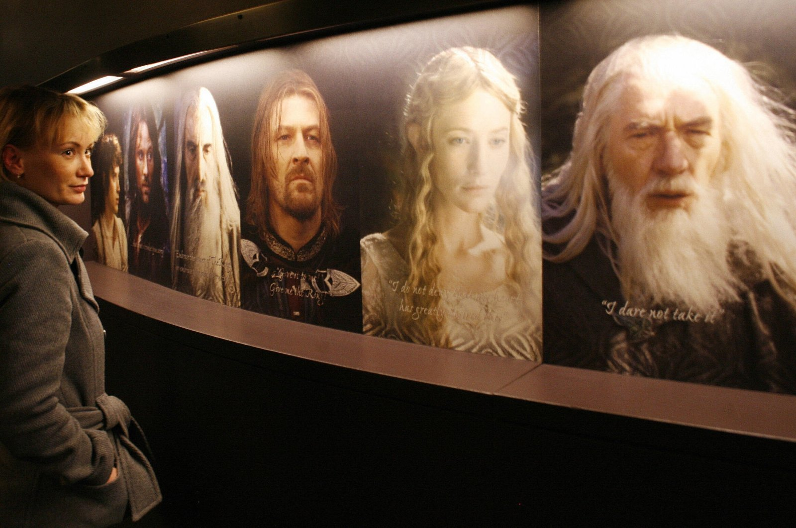 """A woman looks at the different characters from """"The Lord of the Rings"""" films, at an exhibition in Potsdam, eastern Germany, Jan. 30, 2007 . (MICHAEL URBAN/DDP/AFP via Getty Images)"""