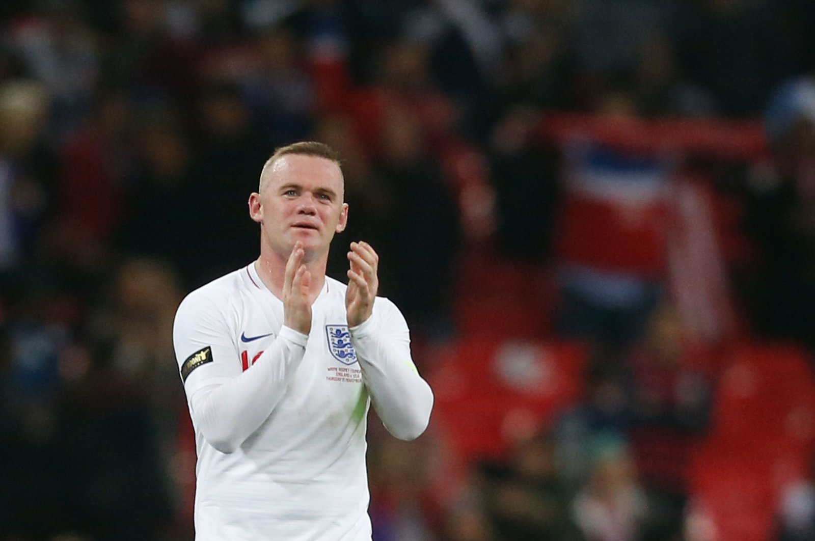 England's striker Wayne Rooney applauds after the final whistle during the international friendly football match between England and the United States at Wembley stadium in north London, Nov. 15, 2018. (AFP Photo)