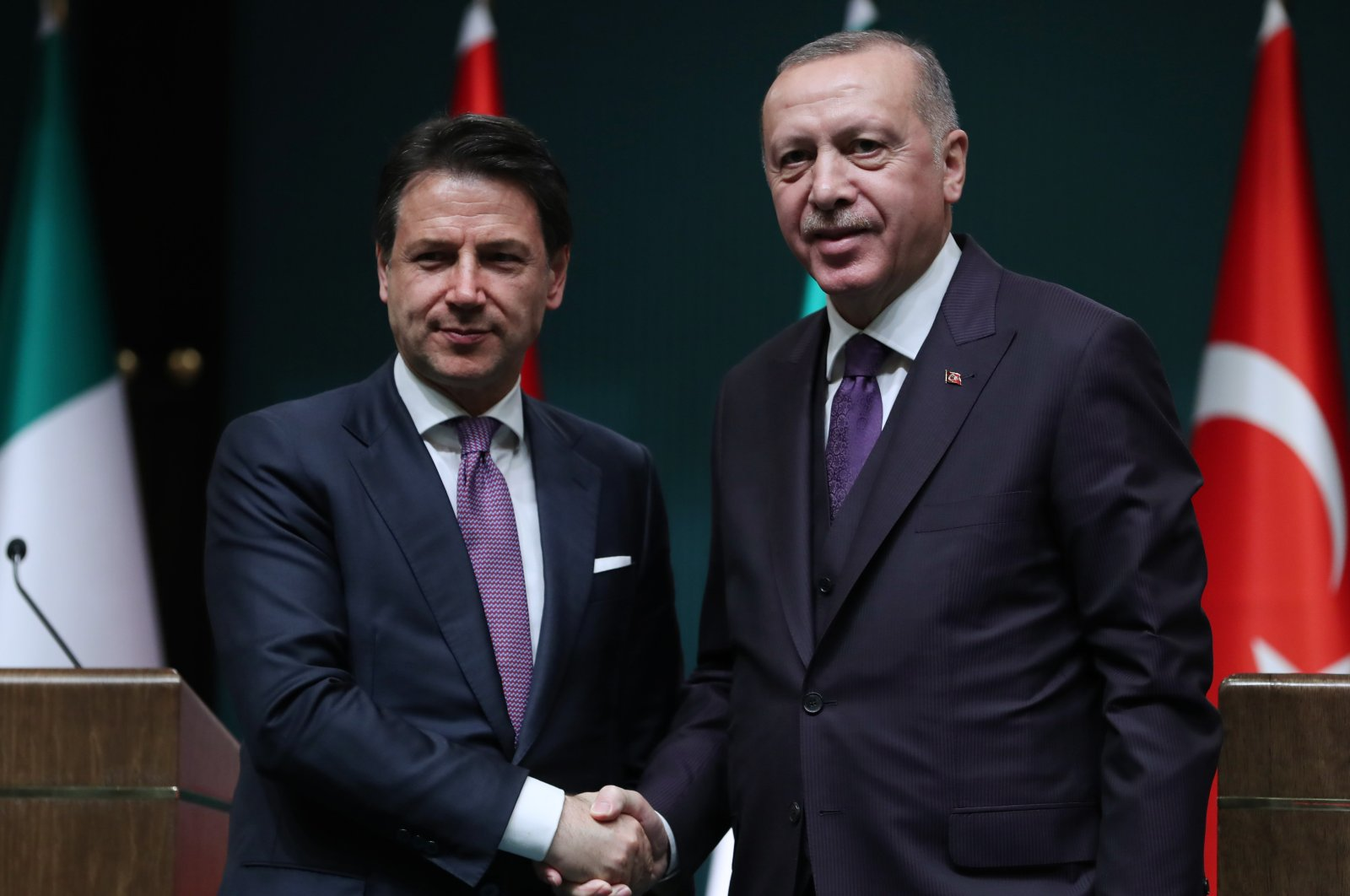 Italian Prime Minister Giuseppe Conte (L) shakes hands with President Recep Tayyip Erdoğan in the capital Ankara, Turkey, Jan. 14, 2020. (AA Photo)