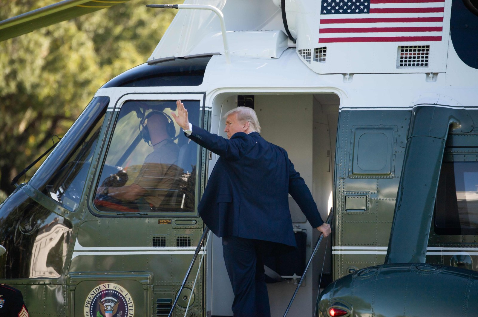U.S. President Donald Trump boards Marine One as he departs the White House in Washington, D.C., Oct. 14, 2020. (AFP Photo)