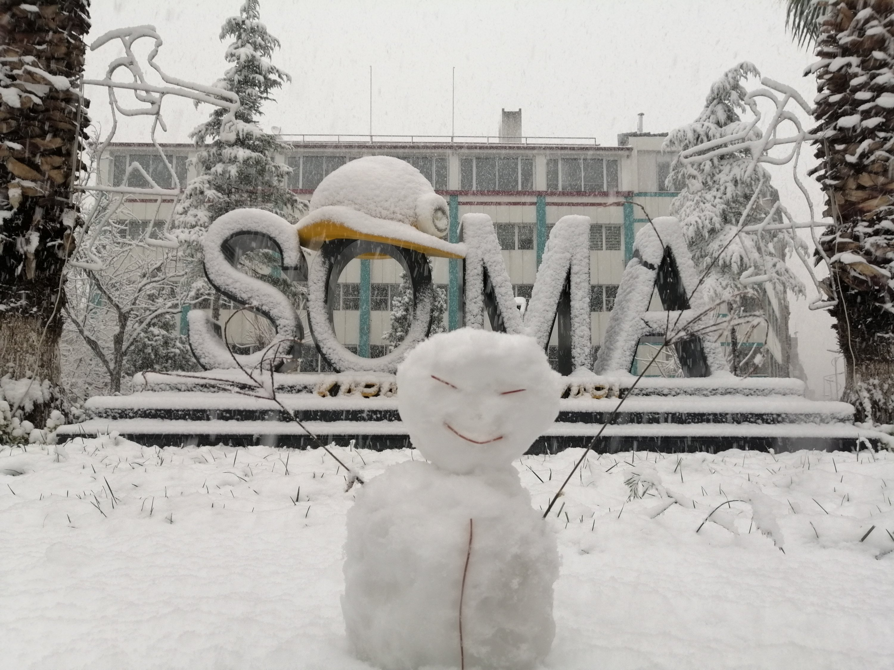 A snowman is seen in front of a landmark in the town Soma, in Manisa, western Turkey, on Jan. 16, 2021. (IHA Photo)