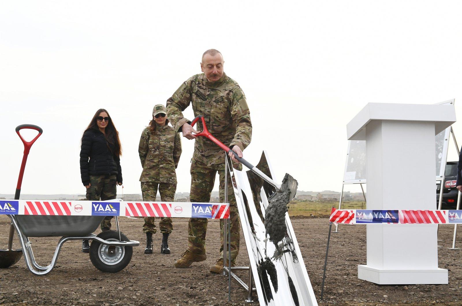 President Ilham Aliyev helps lay the foundation for the Fuzuli airport and Fuzuli-Shusha highway in a recently liberated area of Fuzuli district, Azerbaijan, Jan. 14, 2021. (AA Photo)