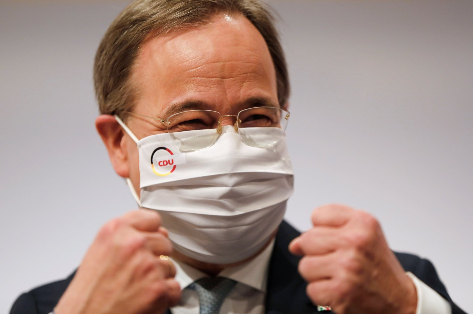 The new elected Christian Democratic Union (CDU) party leader Armin Laschet clenches his fists at the end of the party's 33rd congress held online amid the coronavirus pandemic, in Berlin, Germany, Jan. 16, 2021. (Reuters Photo)