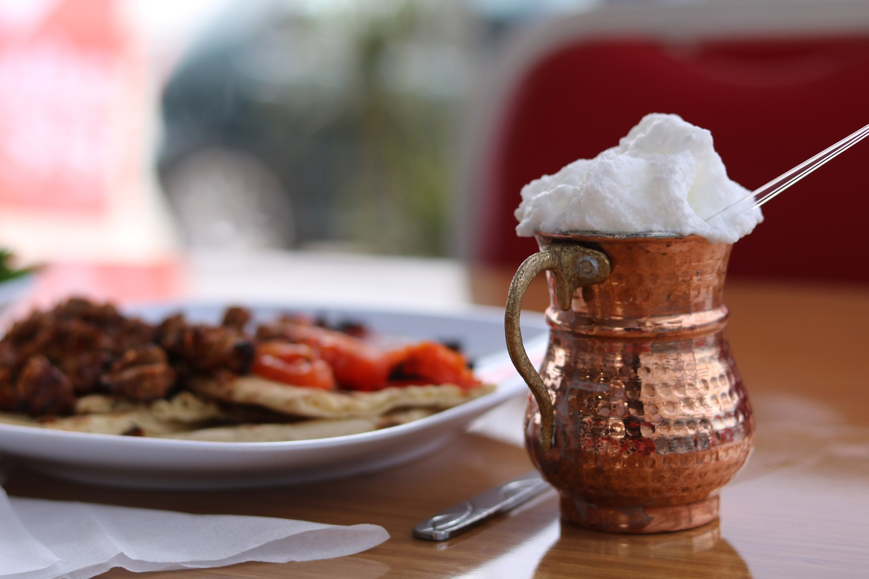 Yayık ayranı (pictured) is frothy and often served with traditional dishes like iskender kebab. (Shutterstock Photo)