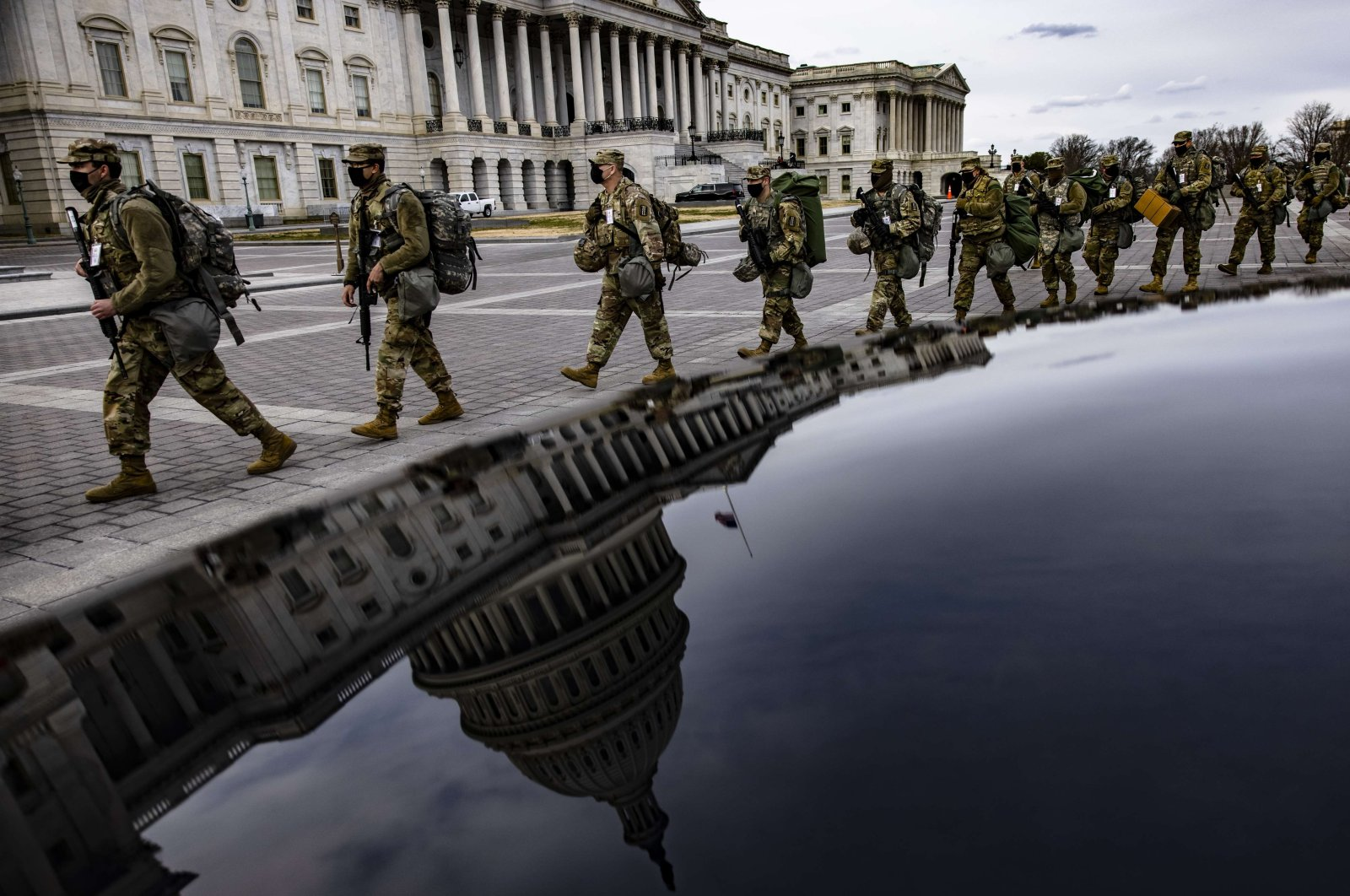 Virginia National Guard soldiers march east of the U.S. Capitol, Washington, D.C., U.S., Jan. 16, 2021. (AFP Photo)