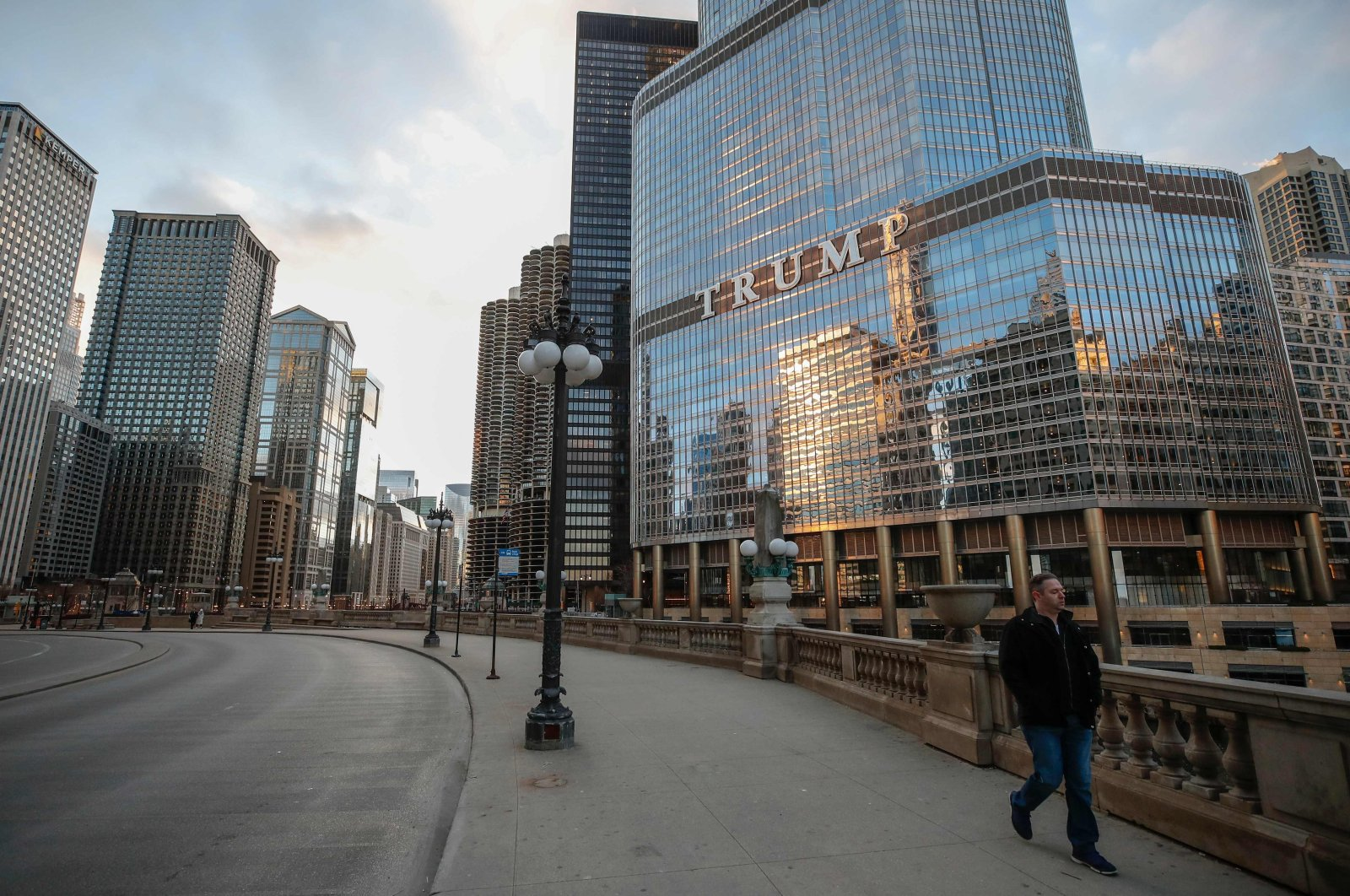A man walks by Trump International Hotel and Tower in Chicago, Illinois, U.S., March 21, 2020. (AFP Photo)