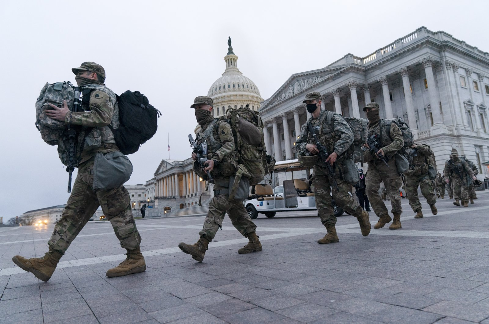 National Guard soldiers walk out of the U.S. Capitol as security is increased ahead of the inauguration of President-elect Joe Biden, Washington, Jan. 16, 2021. (AP Photo)
