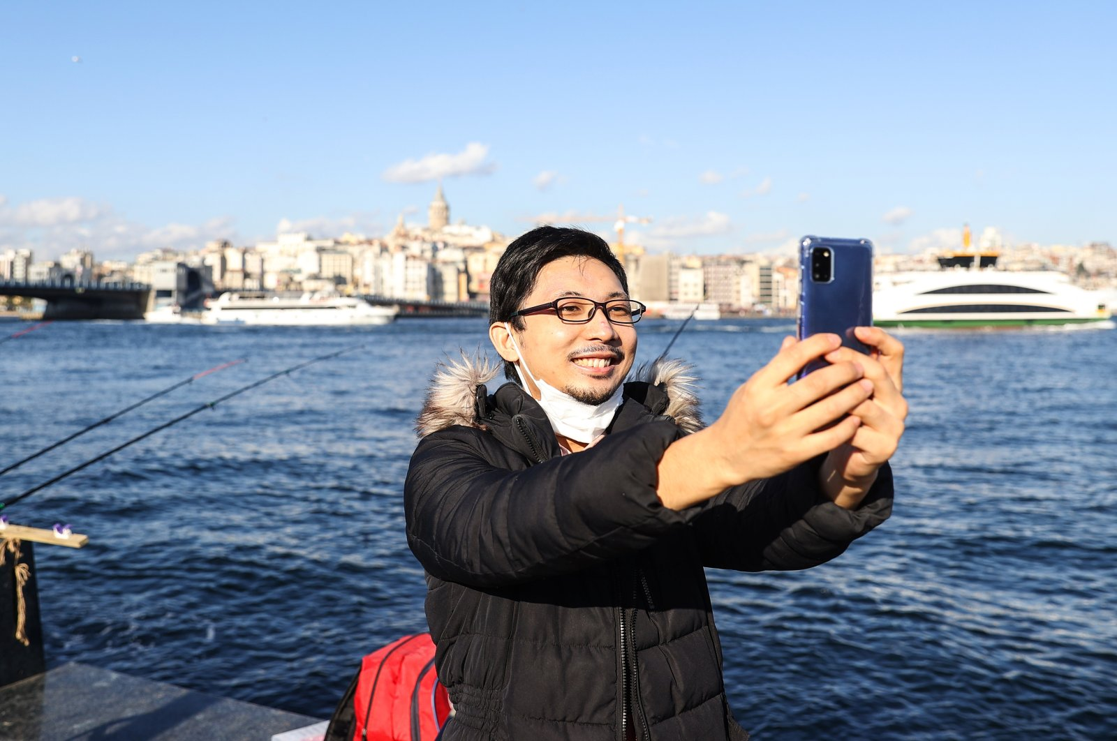 Yoshi Enomoto takes a selfie by the Bosporus, in Istanbul, Turkey, Jan. 17, 2021. (AA PHOTO)