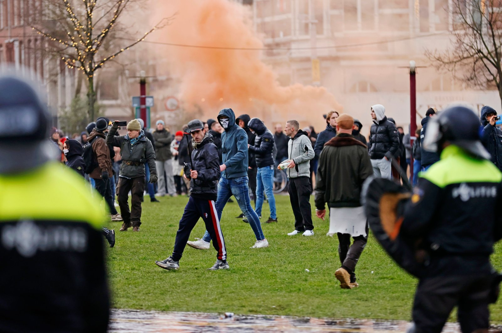 Riot police clash with protesters during a demonstration in the Museumplein town square in Amsterdam, Netherlands on Jan. 17, 2021. (AFP Photo)
